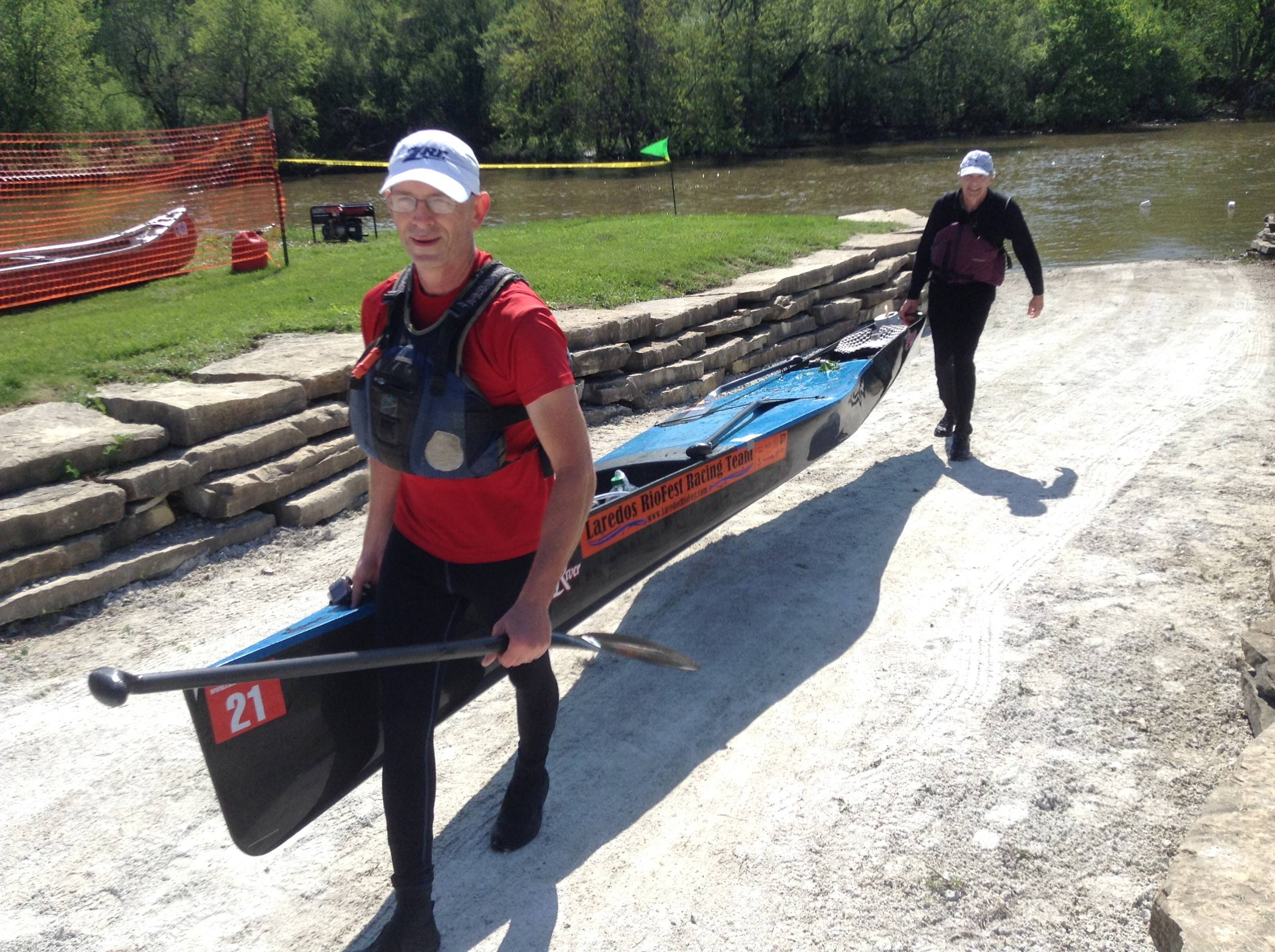 The team of Don Walls and Dale Burris bring in the first canoe to arrive at the finish line Sunday during the Des Plaines River Canoe and Kayak Marathon.