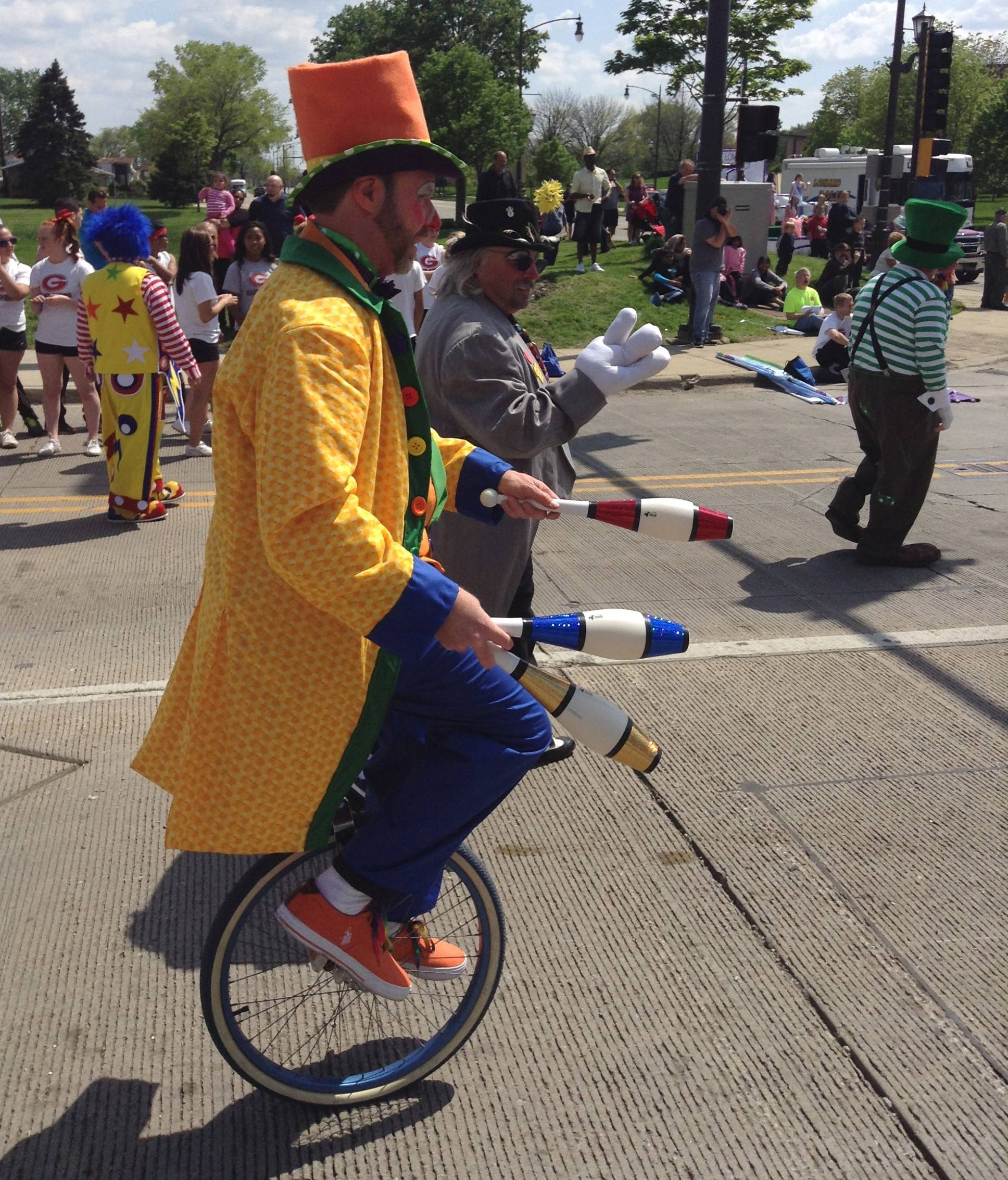 Clowns work hard to put a smile on the faces of the spectators at Sunday's Lilac Parade. More than 100 entries took part in the parade down Lombard's Main Street.