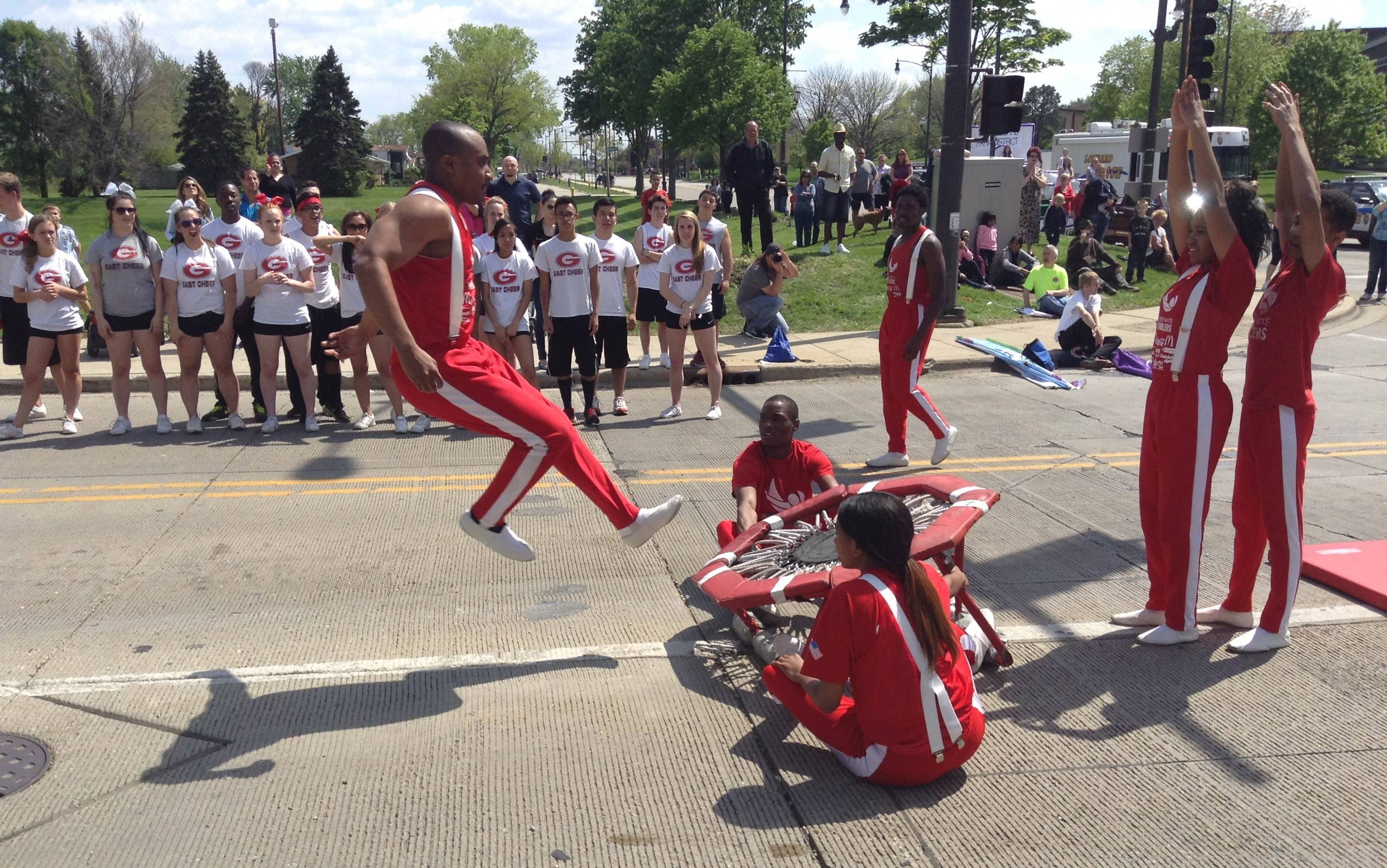 The Jesse White Tumblers wowed the crowd Sunday even as they warmed up before marching in the Lilac Parade. More than 100 entries took part in the parade down Lombard's Main Street.