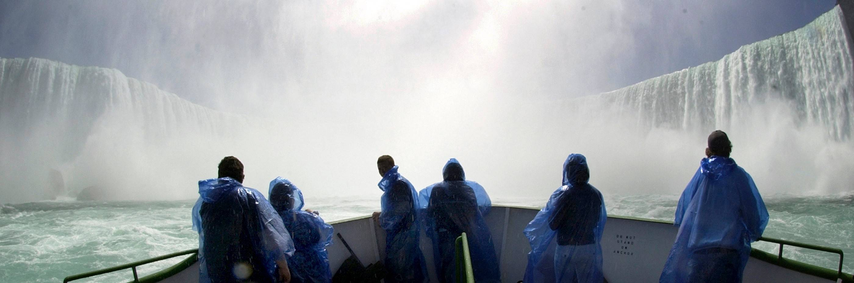 A group of tourists braves opening day on the bow of the Maid of the Mist at the base of the Horseshoe Falls, from Niagara Falls, N.Y. After 150 years of having no competitors at the bottom of the falls, Maid of the Mist tour boats now face a rival.