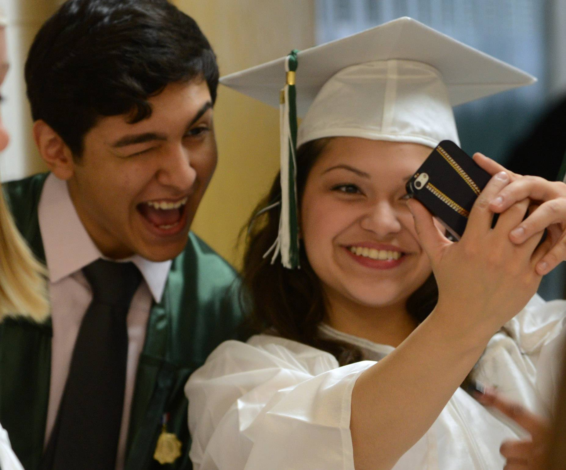 Grayslake Central High School graduates Julio Mondragon, left, and Ashley Torres take a photo Sunday before the school's graduation ceremony.