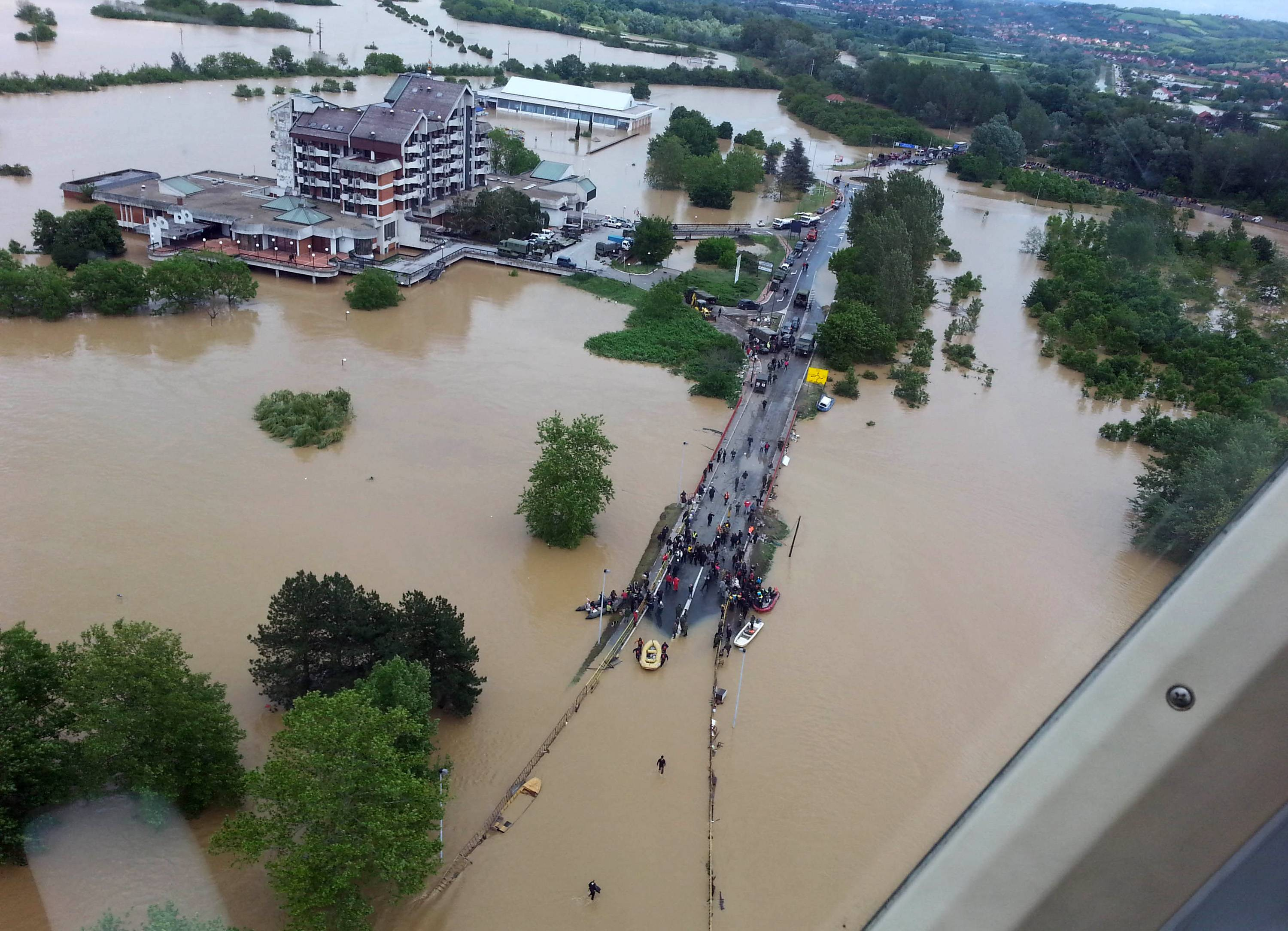 This image made available by the Serbian police shows the flooded area in Obrenovac, 18 miles southwest of Belgrade, Serbia, Sunday. In Serbia, more than 20,000 people have been forced from their homes. Officials there fear more flooding later Sunday as floodwaters travel down the Sava and reach the country.