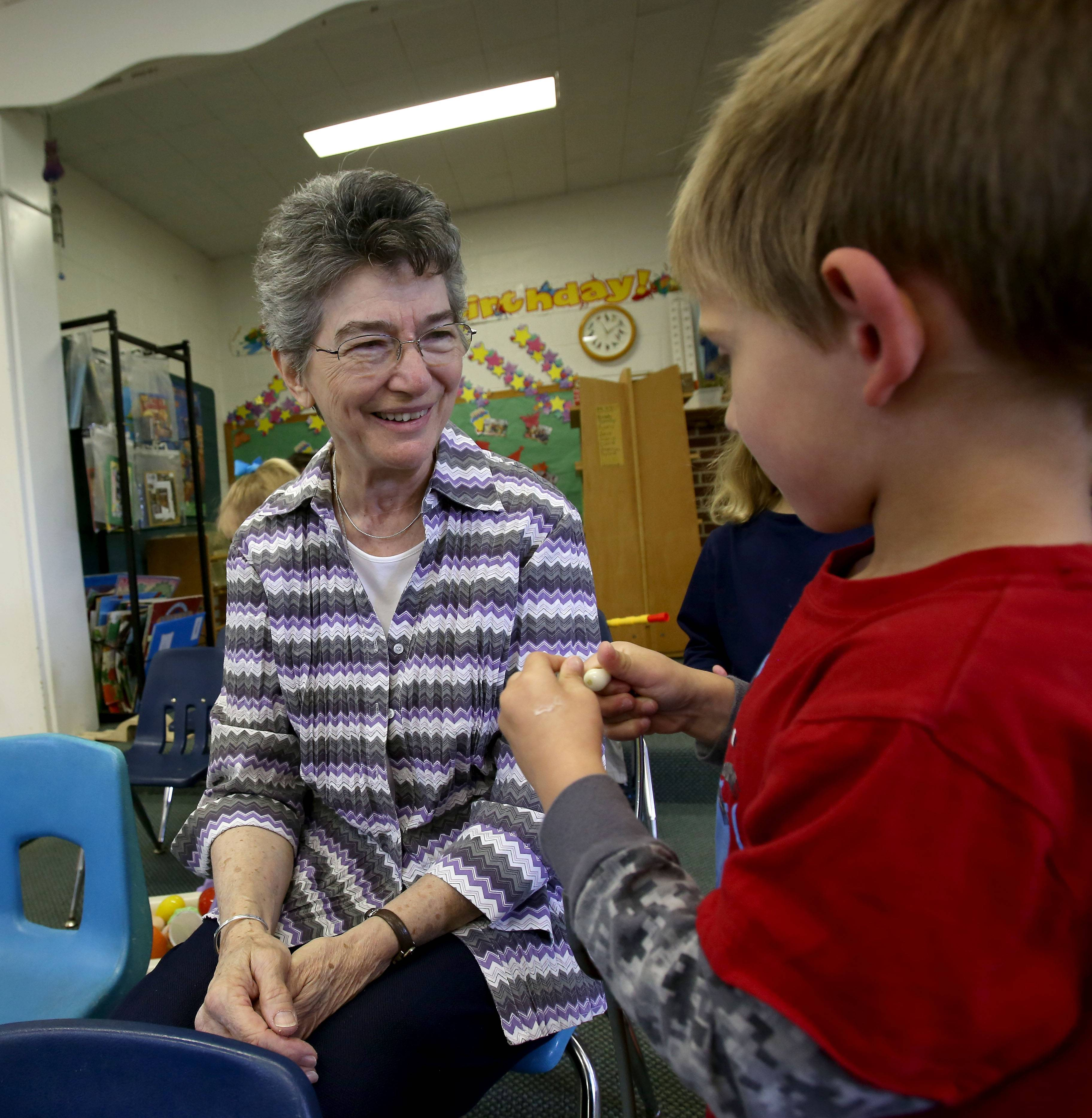 Sister Julie Stapleton chats with Nathan Paige, 4, at the Loretto Early Childhood Center.