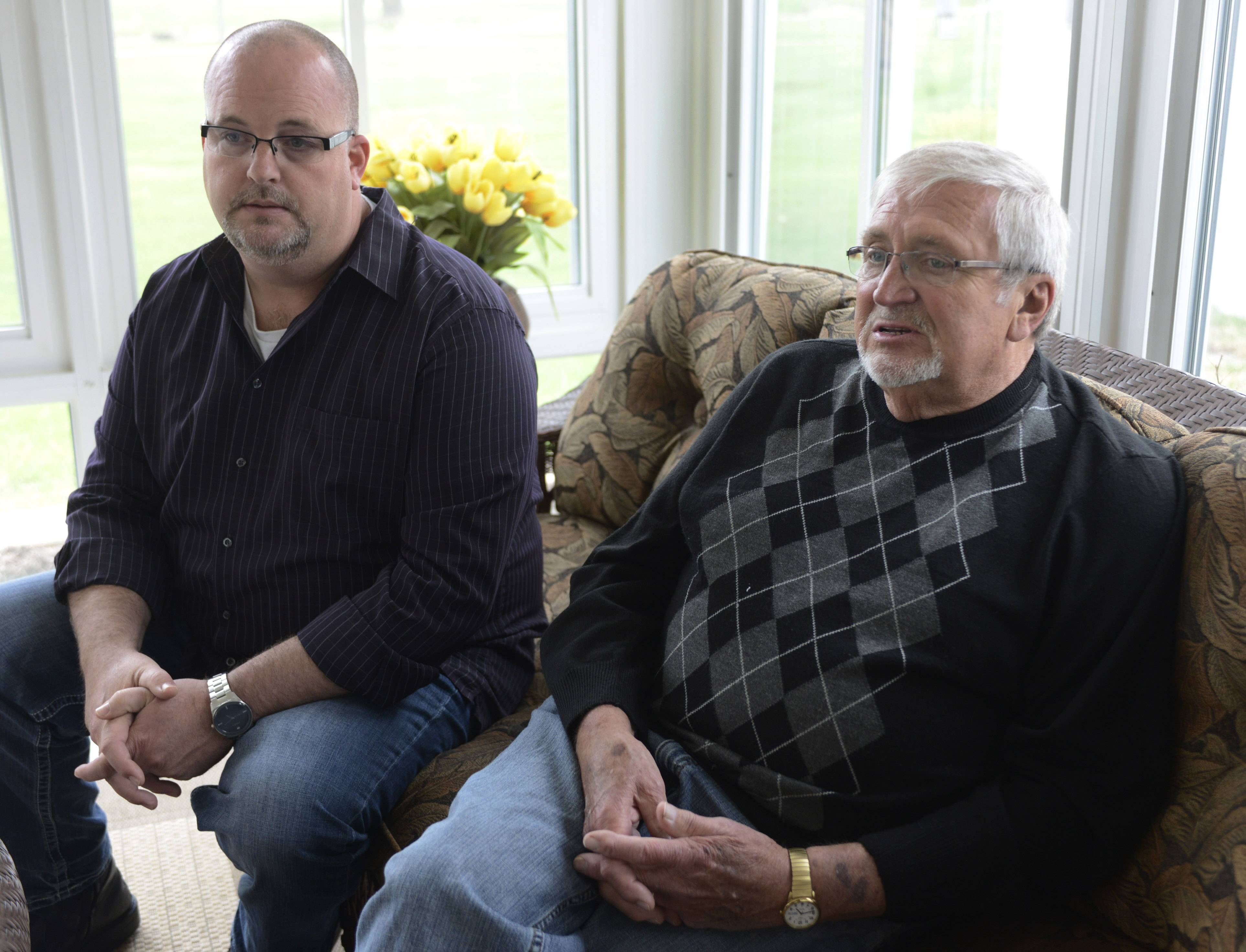 Seated with his son, Steve, Schaumburg Village Trustee Frank Kozak, right, and his wife, Char, recall how they narrowly survived a tornado that killed 29 people and caused an estimated $2 billion damage in the Oklahoma City area last year.