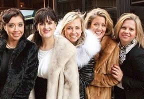 Her life as an event planner is filled with glamorous furs, champagne and beautiful people, but Mount Prospect native Shari Duffy, second from right, says she has to balance the nights of parties with her more important job of being a mother.