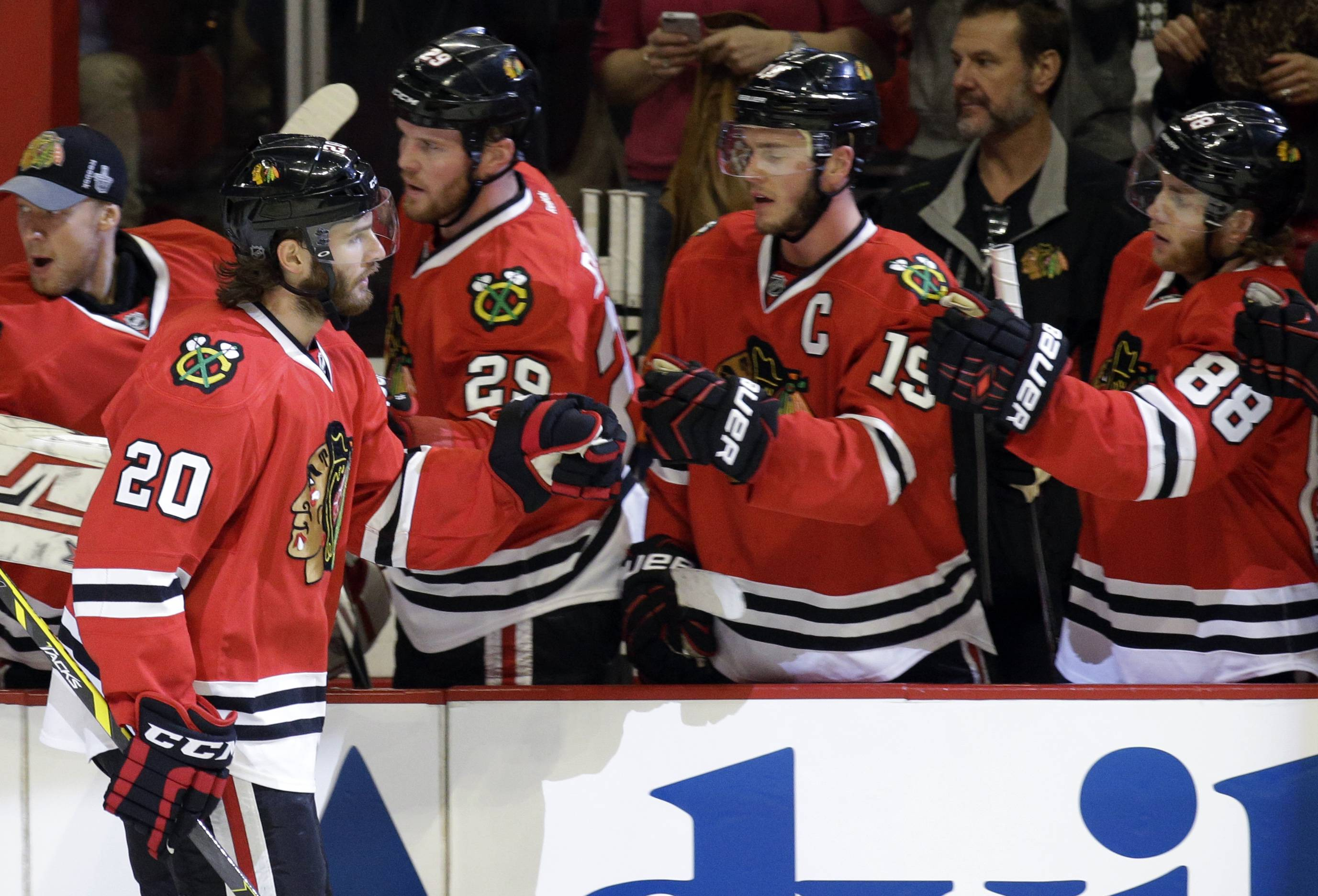 Chicago Blackhawks' Brandon Saad (20) celebrates with teammates after scoring a goal against the Los Angeles Kings during the first period.