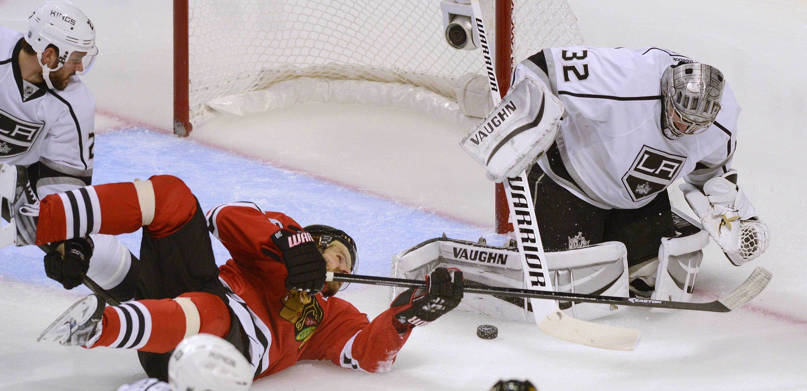 Chicago Blackhawks center Michal Handzus tries to score while sliding on his side as Los Angeles Kings goalie Jonathan Quick makes a save during Sunday's game at the United Center in Chicago.