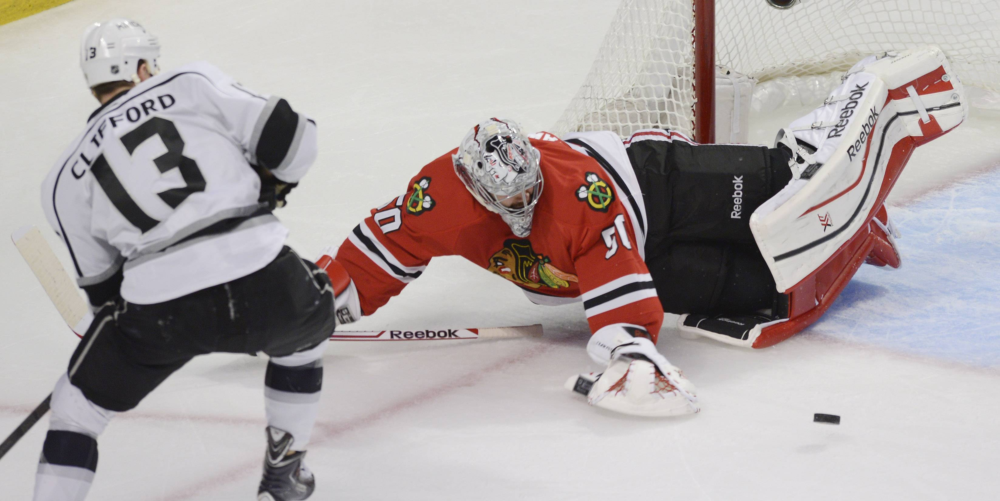 Chicago Blackhawks goalie Corey Crawford makes a save on a second-period shot by Los Angeles Kings left wing Kyle Clifford during Sunday's game at the United Center in Chicago.