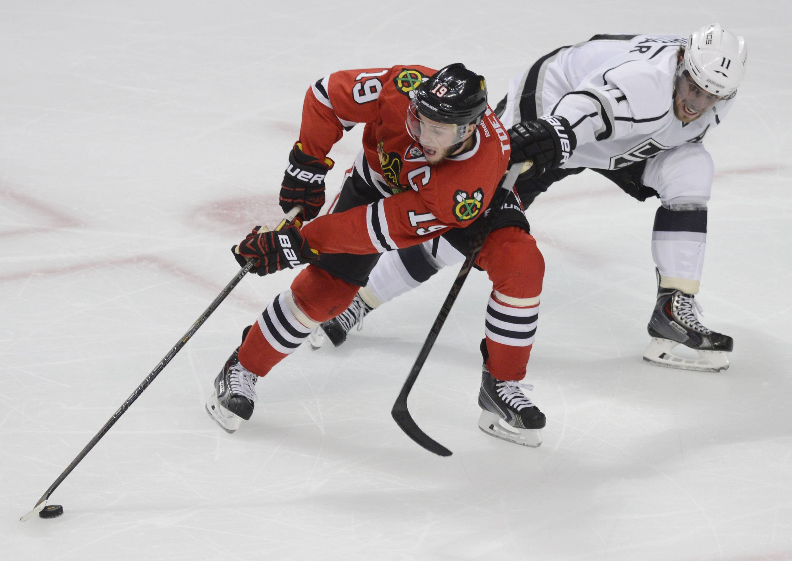 Chicago Blackhawks center Jonathan Toews tries to get past Los Angeles Kings center Anze Kopitar during Sunday's game at the United Center in Chicago.