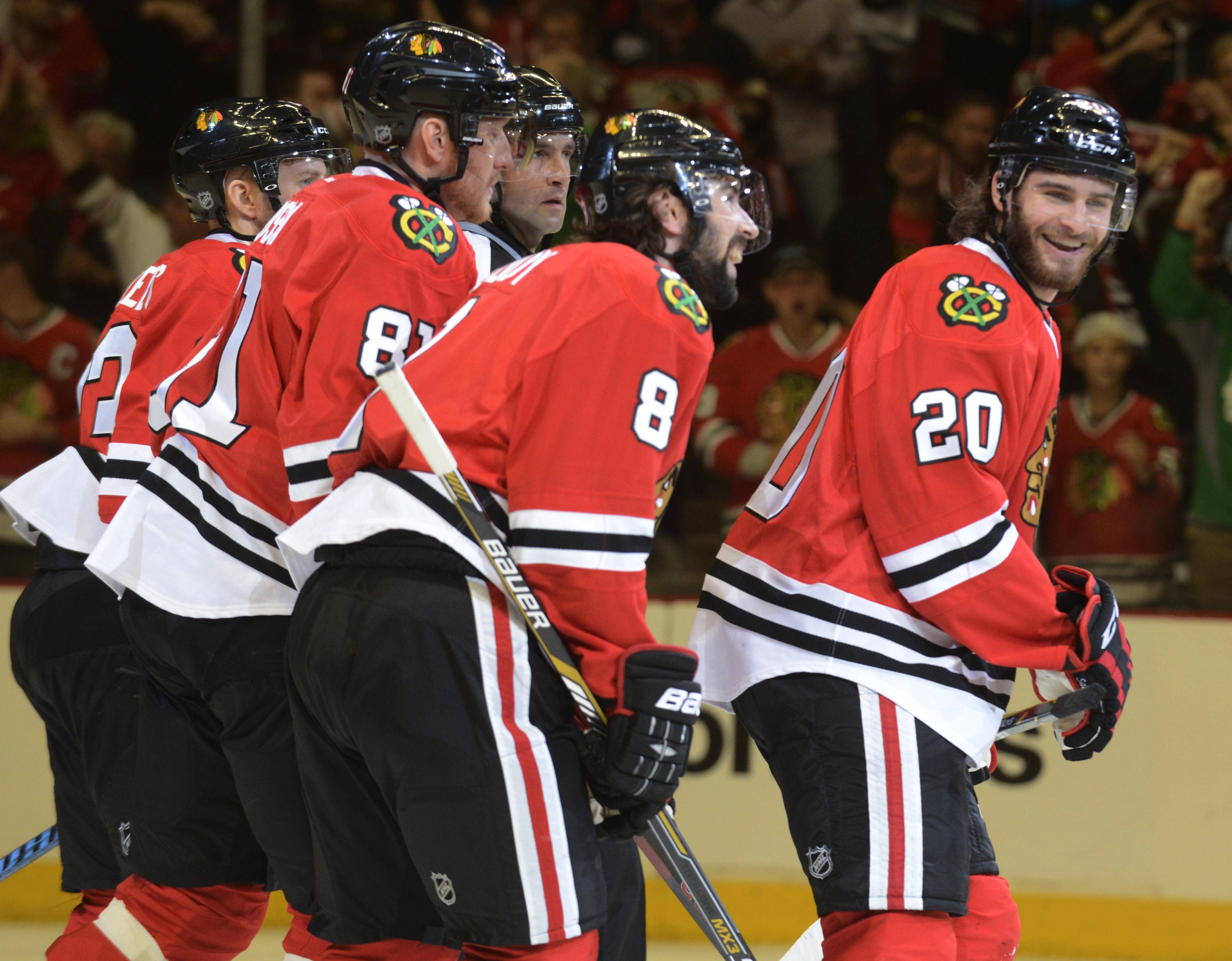 Chicago Blackhawks left wing Brandon Saad, right, celebrates his first-period goal with his teammates during Sunday's game against the Los Angeles Kings at the United Center in Chicago.