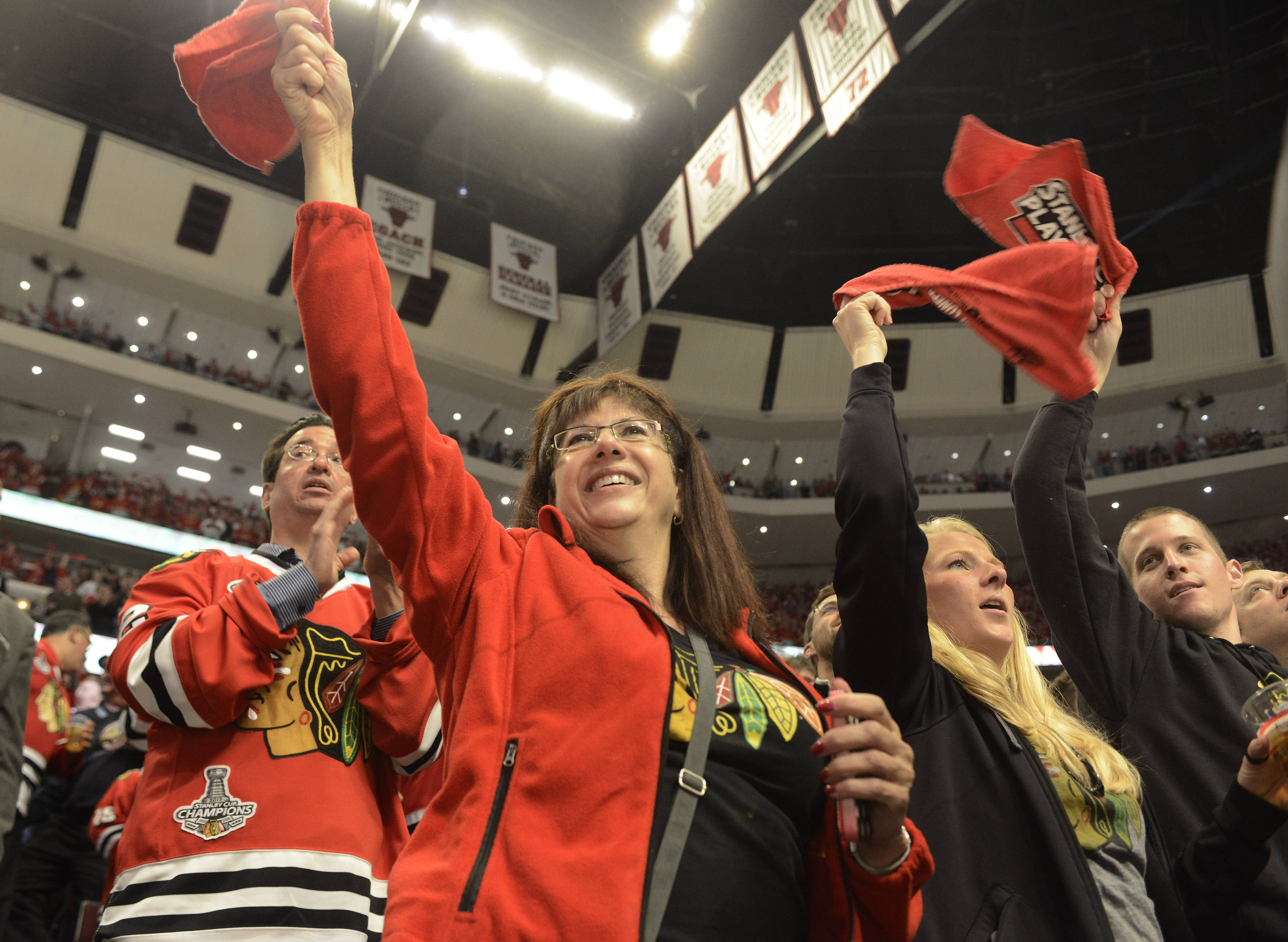 With their team ahead 1-0 over the Los Angeles Kings fans celebrate at the end of the first period during Sunday's game against the Los Angeles Kings at the United Center in Chicago. The Blackhawks won the opening game of the Western Conference finals 3-1.