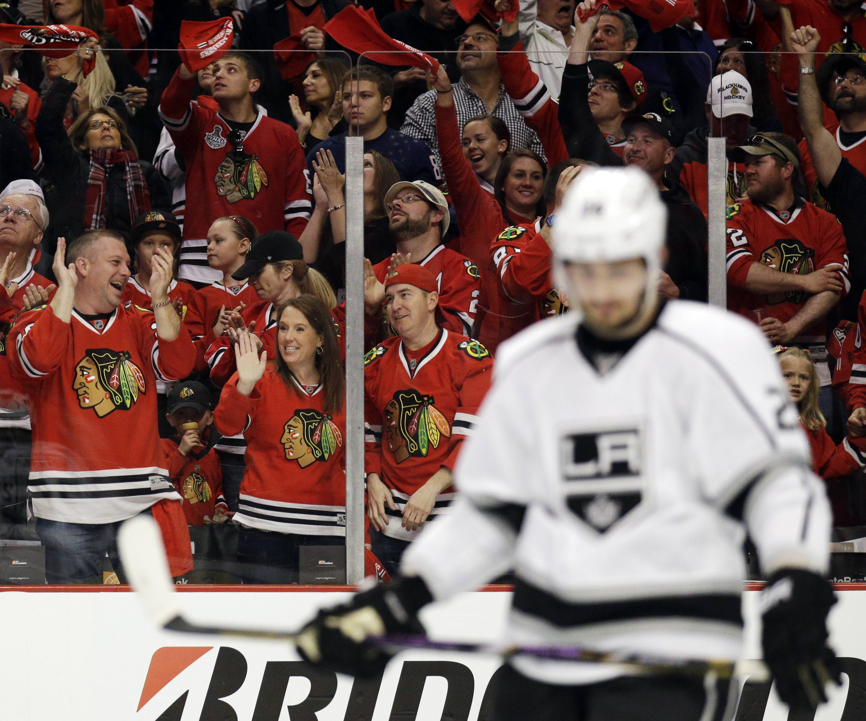 Chicago Blackhawks fans celebrates after Duncan Keith scored as Los Angeles Kings' Slava Voynov (26) looks down during the second period.