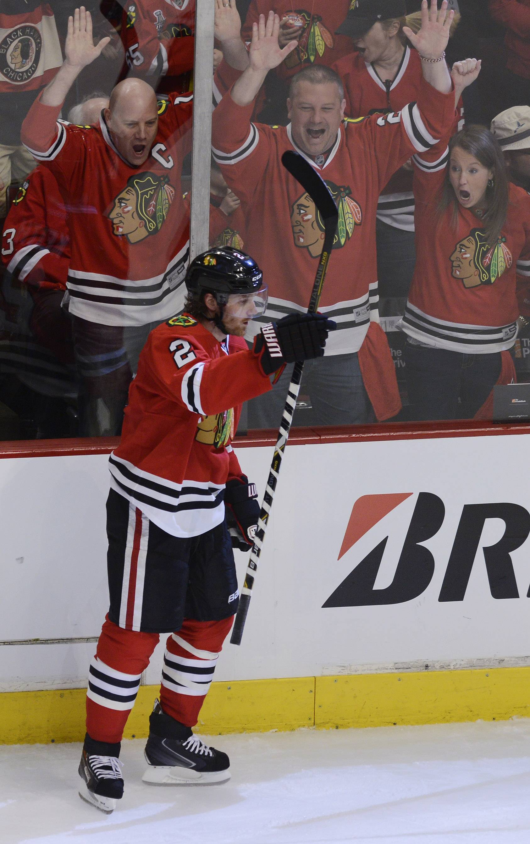 Chicago Blackhawks defenseman Duncan Keith raises his stick in the air as fans celebrate his second period goal during Sunday's game against the Los Angeles Kings at the United Center in Chicago.