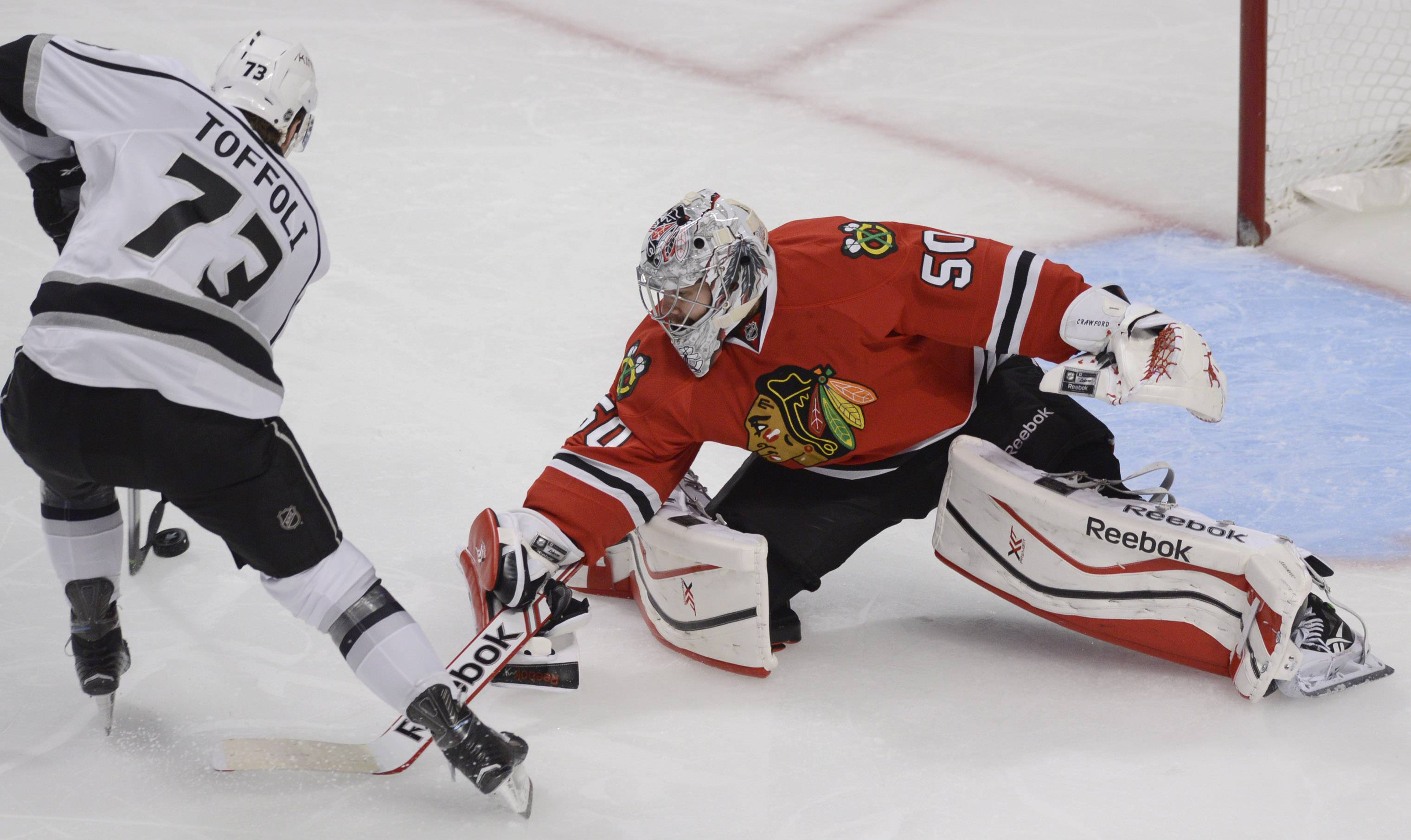 Chicago Blackhawks goalie Corey Crawford, right, makes a save on a shot by Los Angeles Kings center Tyler Toffoli during the third period.