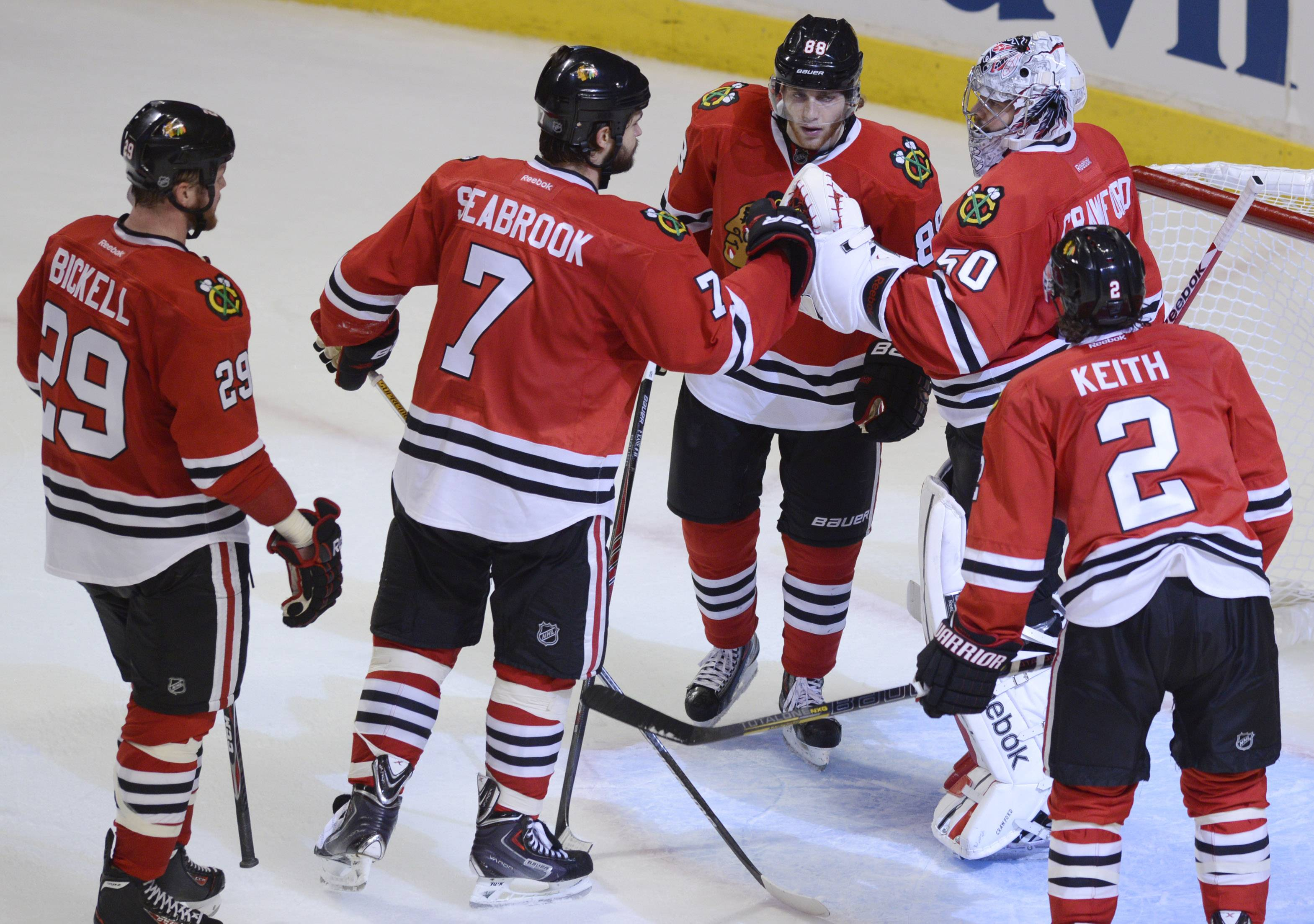 Left to right, Chicago Blackhawks Bryan Bickell, Brent Seabrook, Patrick Kane, goalie Corey Crawford and Duncan Keith celebrate their win over the Los Angeles Kings Sunday.