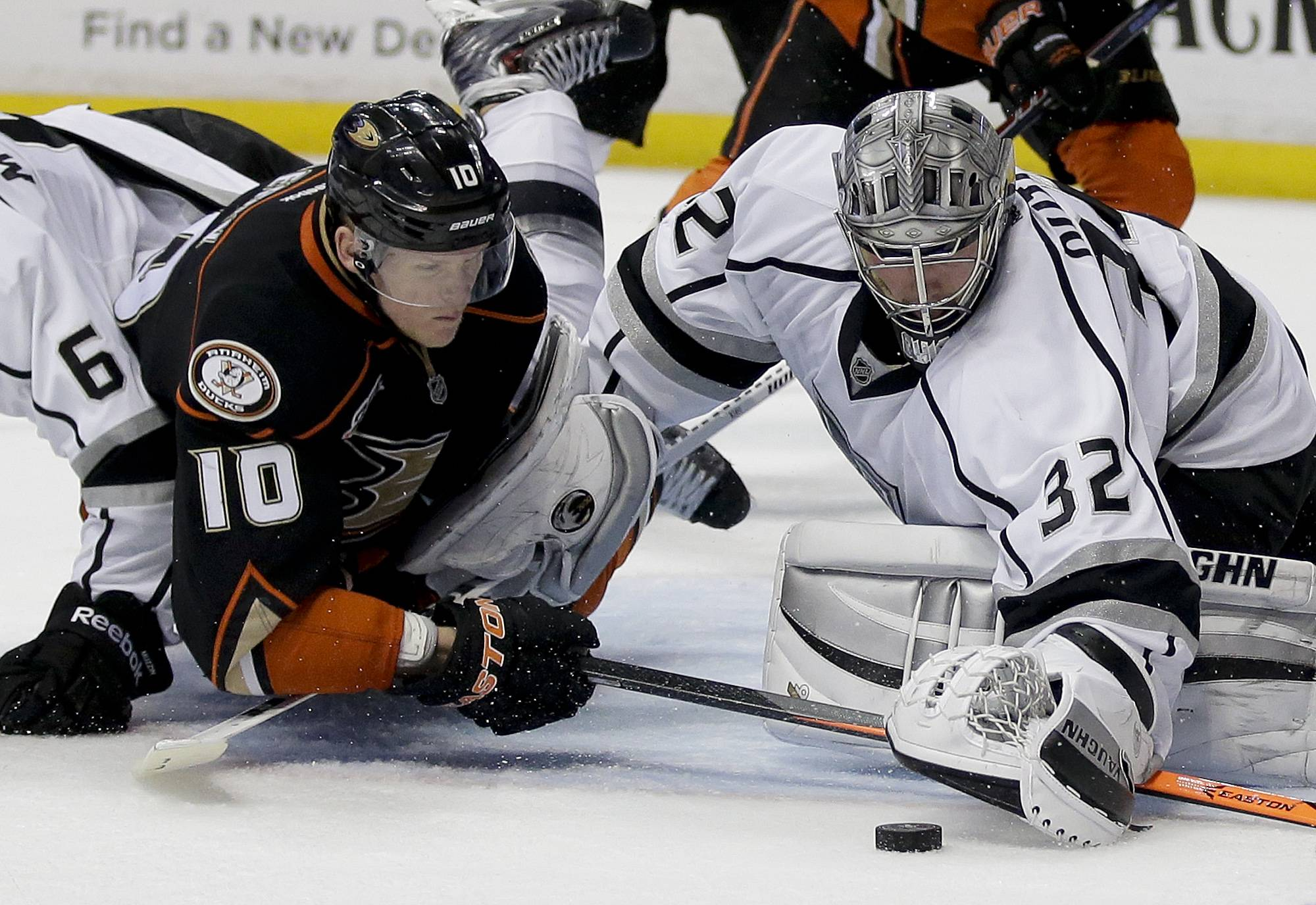 Los Angeles Kings goalie Jonathan Quick, right, blocks a shot by Anaheim Ducks right wing Corey Perry during the second period in Game 7 of an NHL hockey second-round Stanley Cup playoff series in Anaheim, Calif., Friday, May 16, 2014.