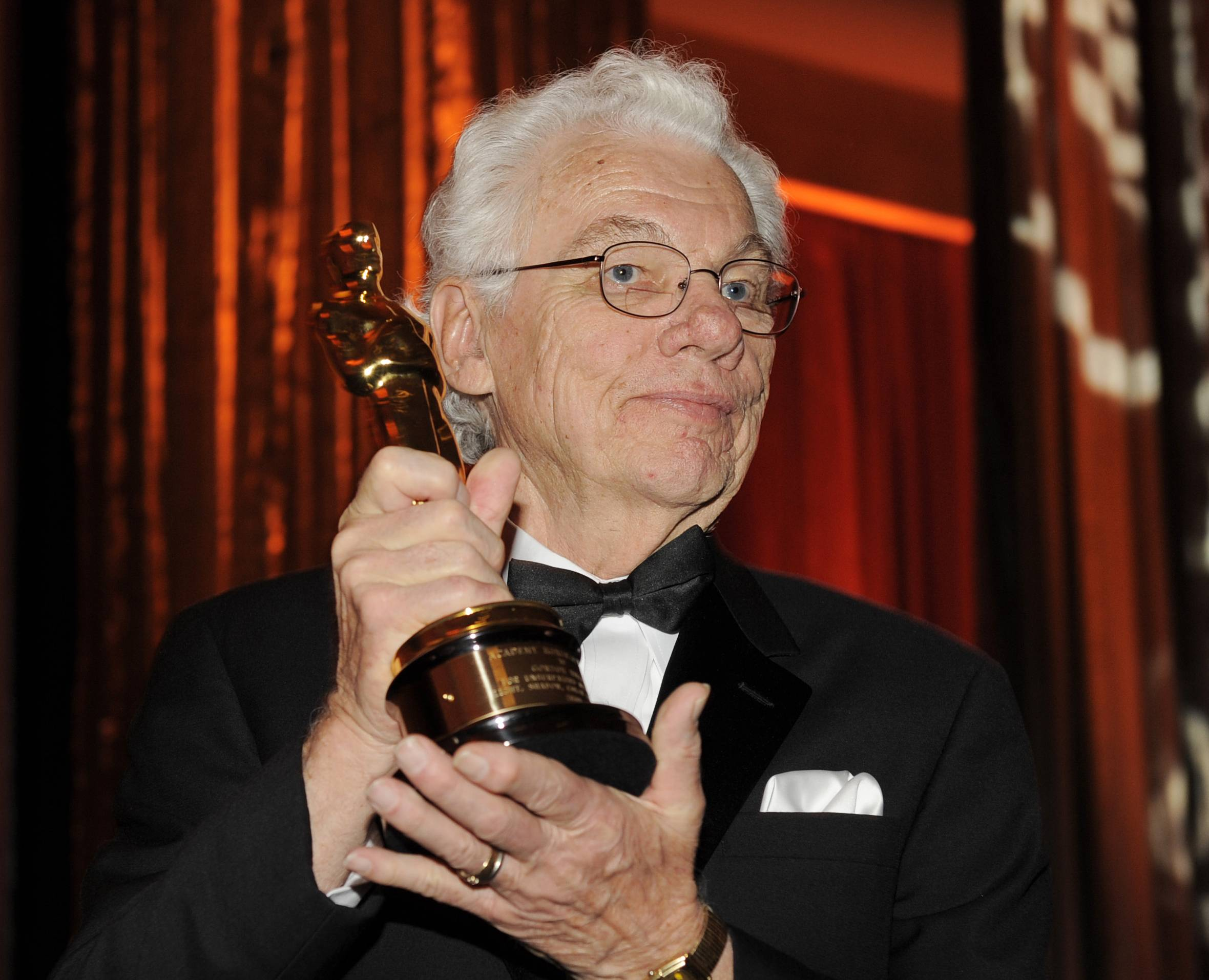 Cinematographer Gordon Willis poses with his honorary Oscar following The Academy of Motion Picture Arts and Sciences 2009 Governors Awards in Los Angeles. Willis died at age 82.