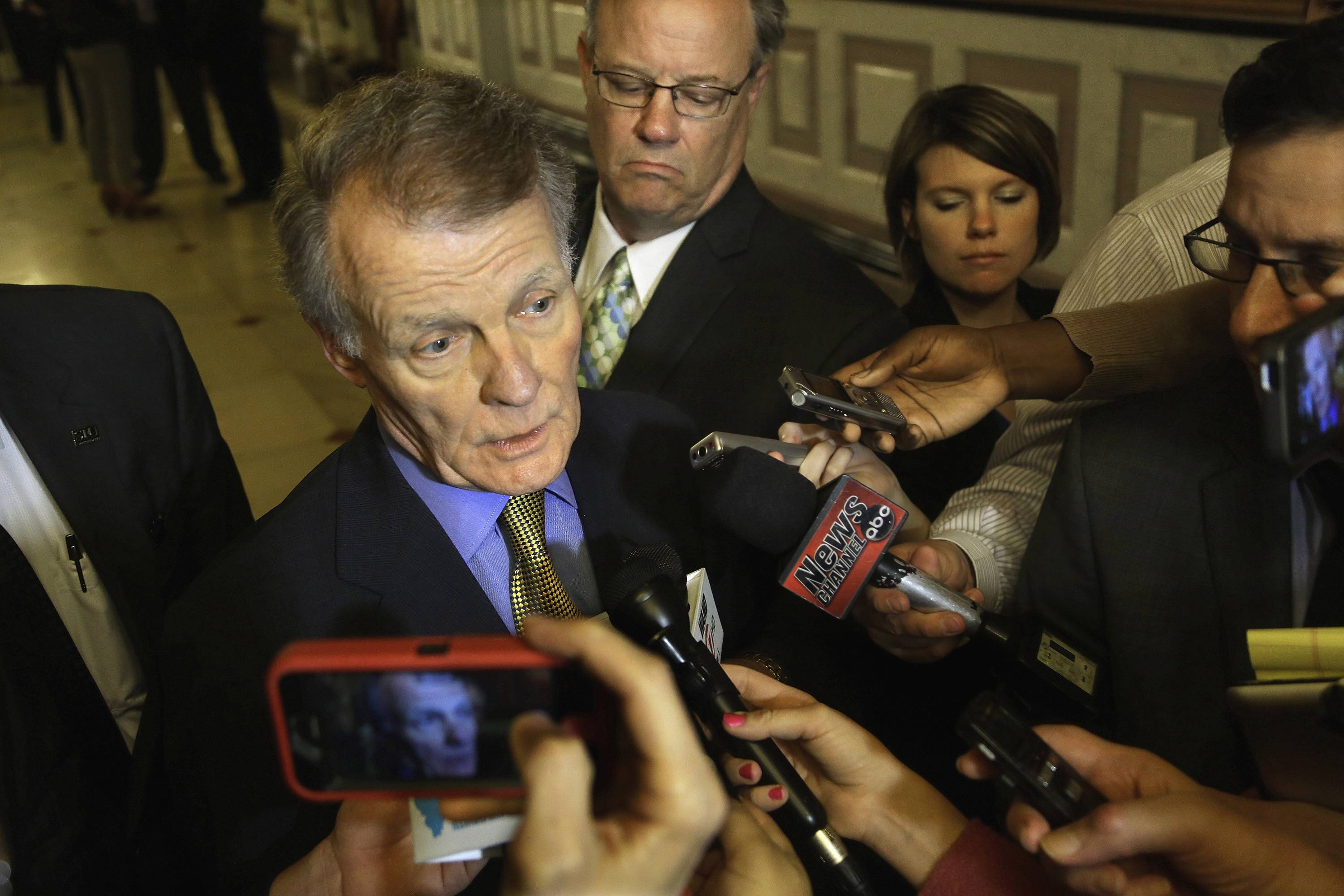 Reporters surround House Speaker Michael Madigan after he testified last week in a committee hearing at the state Capitol in Springfield. Madigan, also the state Democratic Party chairman, has an arsenal of carrots and sticks at his disposal.