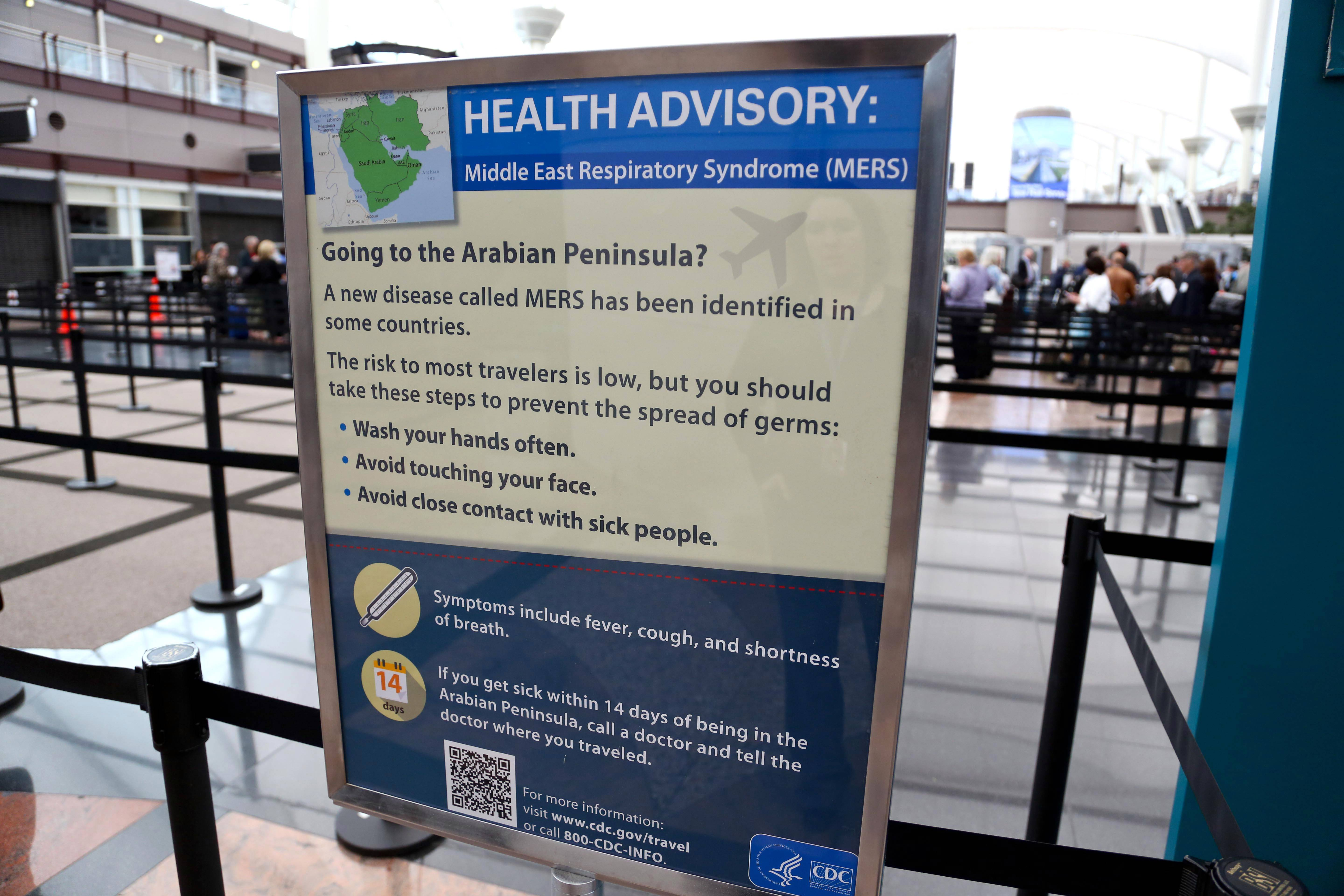 Newly-erected signs warning travelers about he danger of the MERS virus were erected last week at Denver International Airport. The airport said the signs were posted at all of its screening areas at the direction of the Centers for Disease Control.