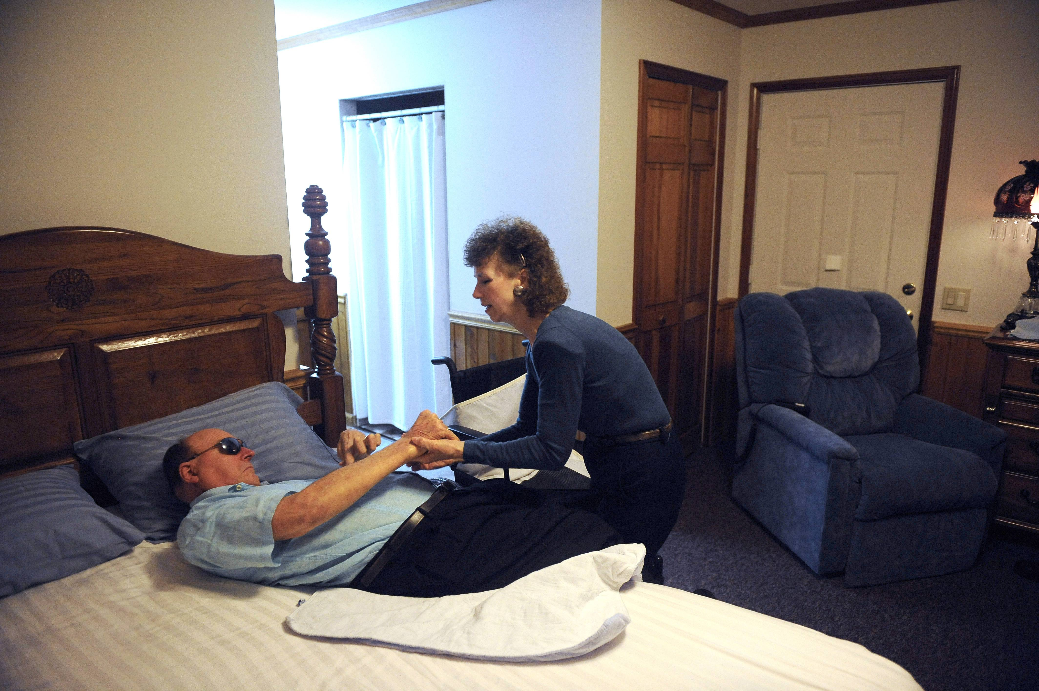 Pauline King cares for her husband Jerry King at their home in Anna, Ill. Jerry was diagnosed with Multiple Sclerosis in 1978. He can no longer go to the bathroom, bathe or dress himself without assistance from Pauline.