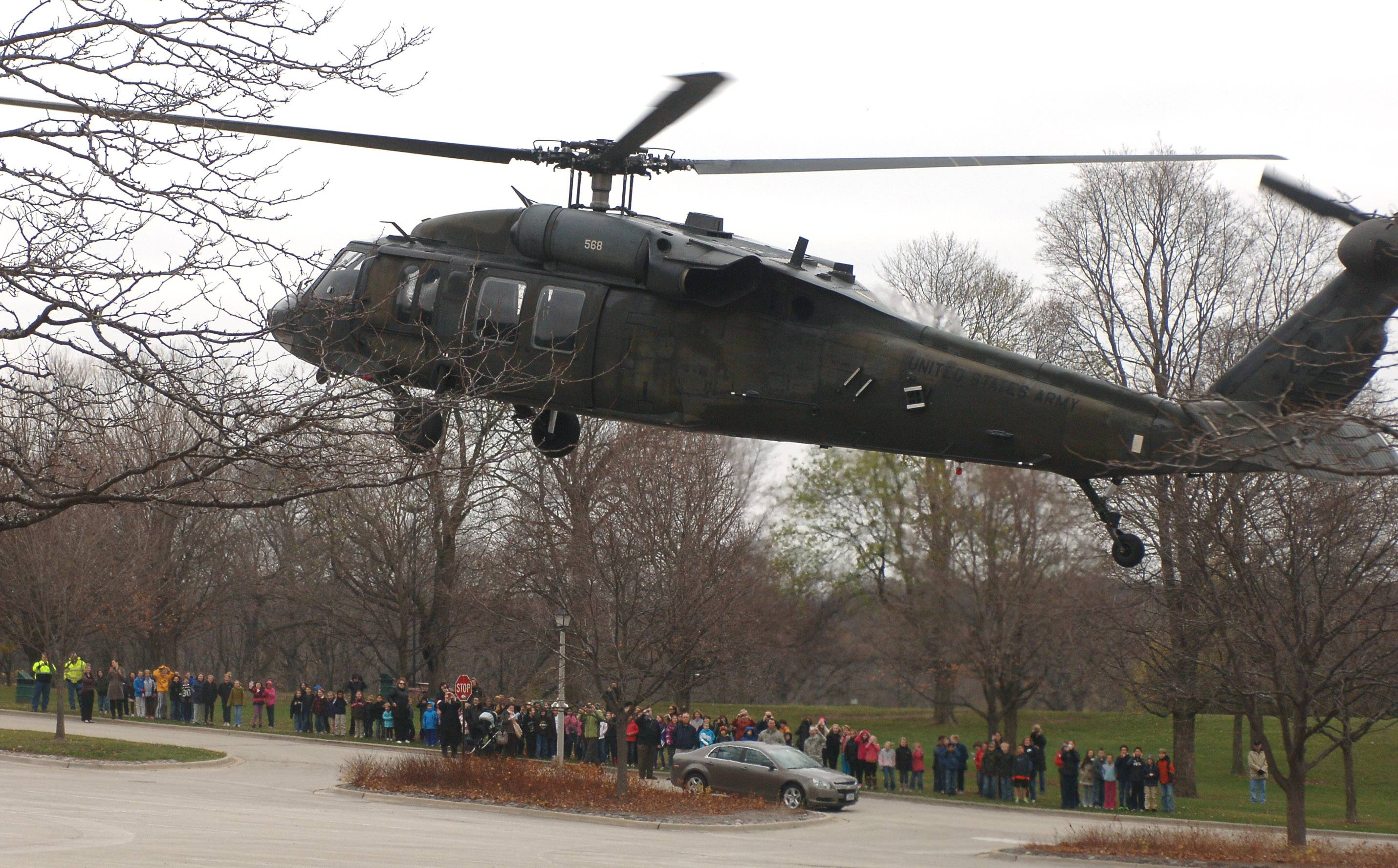 Adler Park School students watch as a United States Army National Guard Blackhawk helicopter lands in Libertyville as part of a Veterans Day event at the school.
