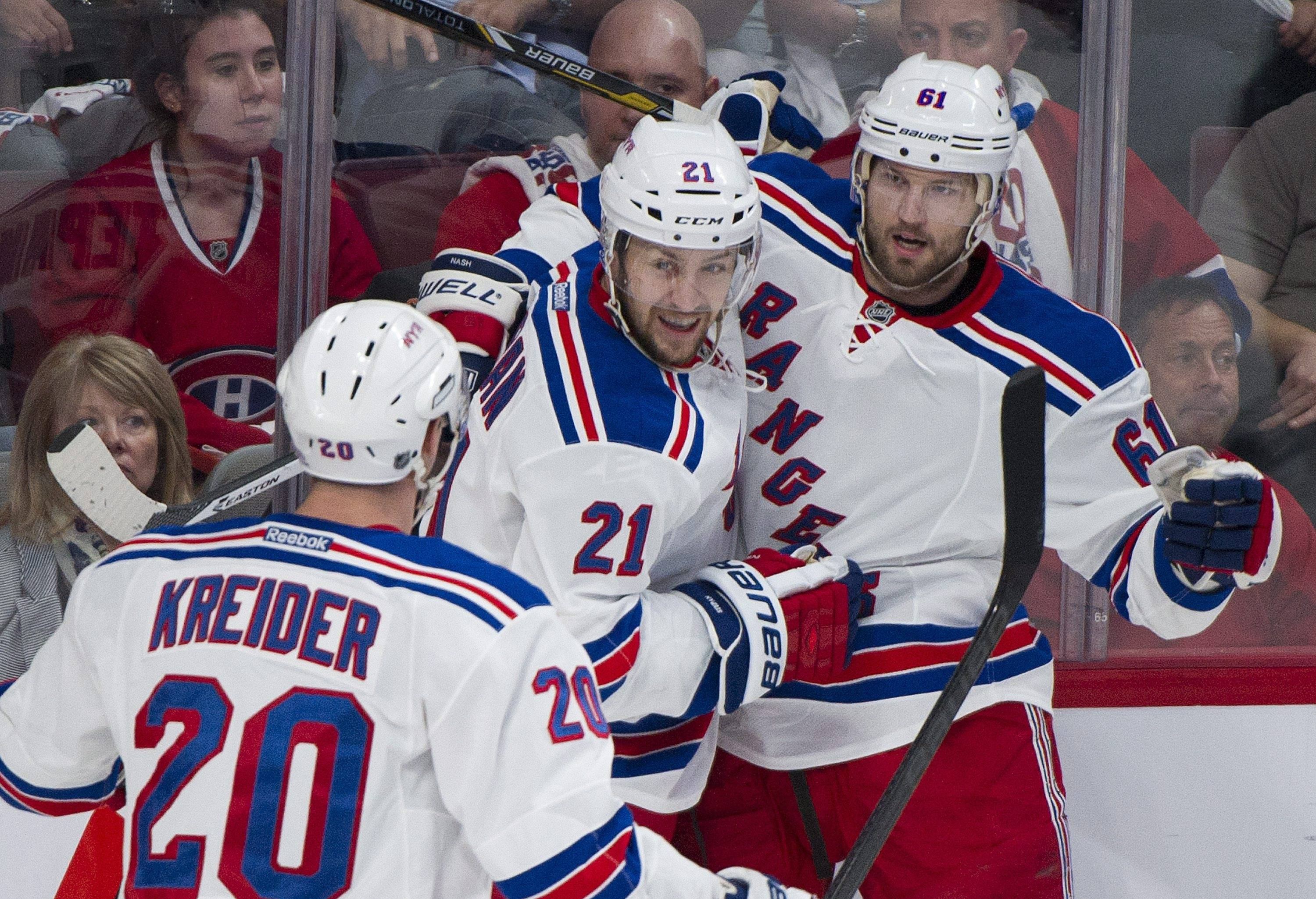 New York Rangers' Rick Nash (61) celebrates with teammates Chris Kreider (20) and Derek Stepan after scoring against the Montreal Canadiens during the first period Monday in Game 2 of the NHL Eastern Conference final Stanley Cup playoff game in Montreal.
