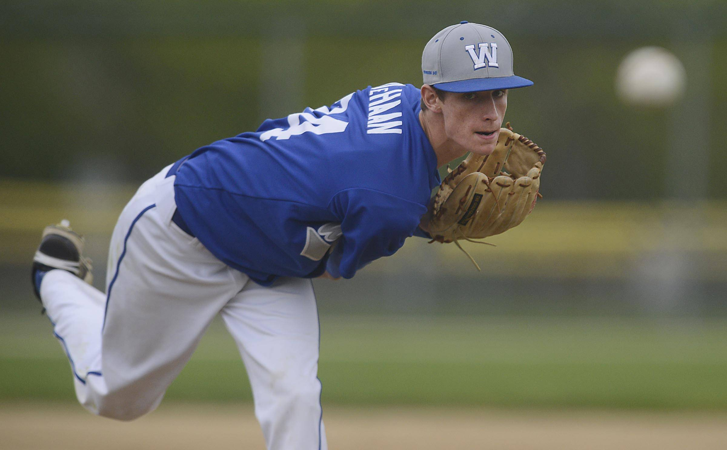 Westminster Christian's Clay DeHaan delivers against St. Edward Monday in the Class 2A regional game at Wing Park in Elgin.
