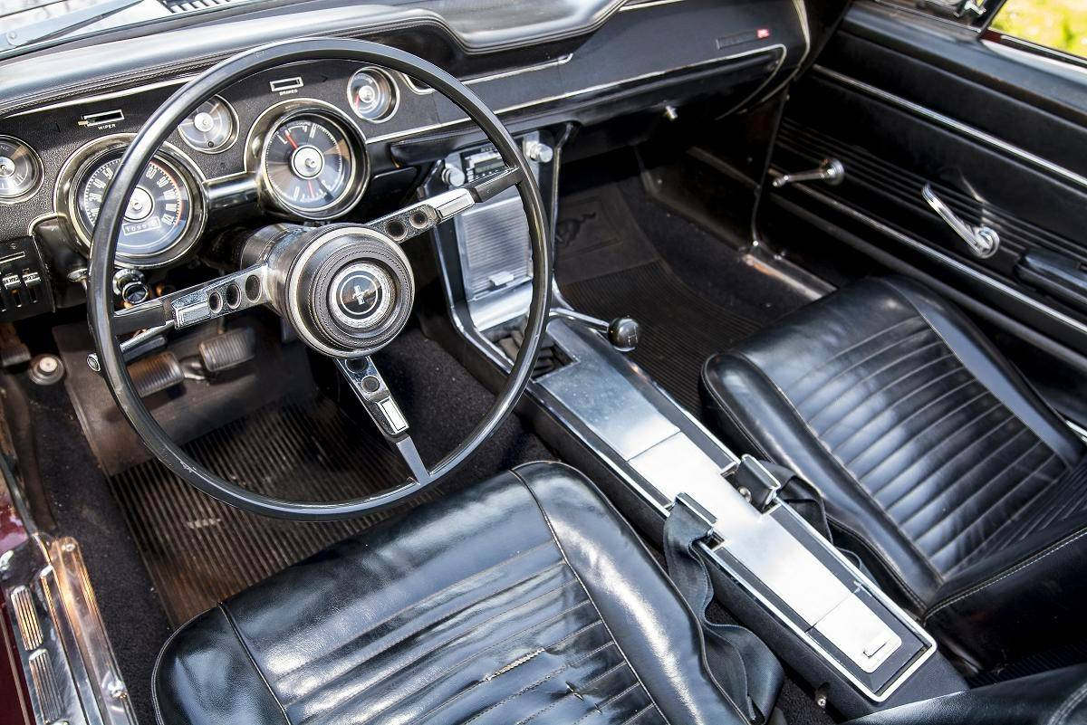 The black leather interior has been preserved, though the carpeting has been replaced.