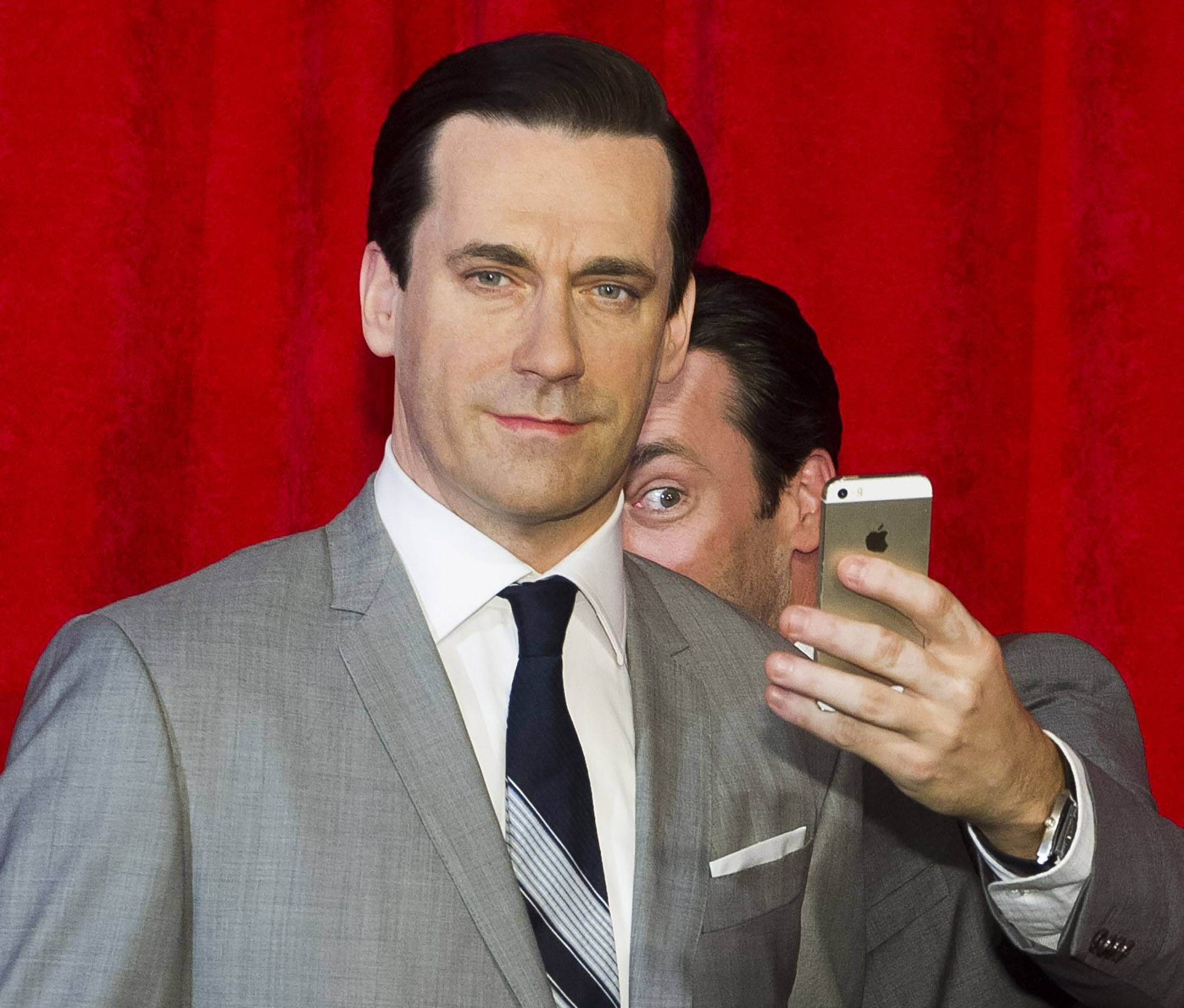 Actor Jon Hamm takes a selfie at the unveiling of his wax figure recently at Madame Tussauds in New York. Selfie is one of the 150 new words appearing in Merriam-Webster's Collegiate Dictionary and the company's free online database.