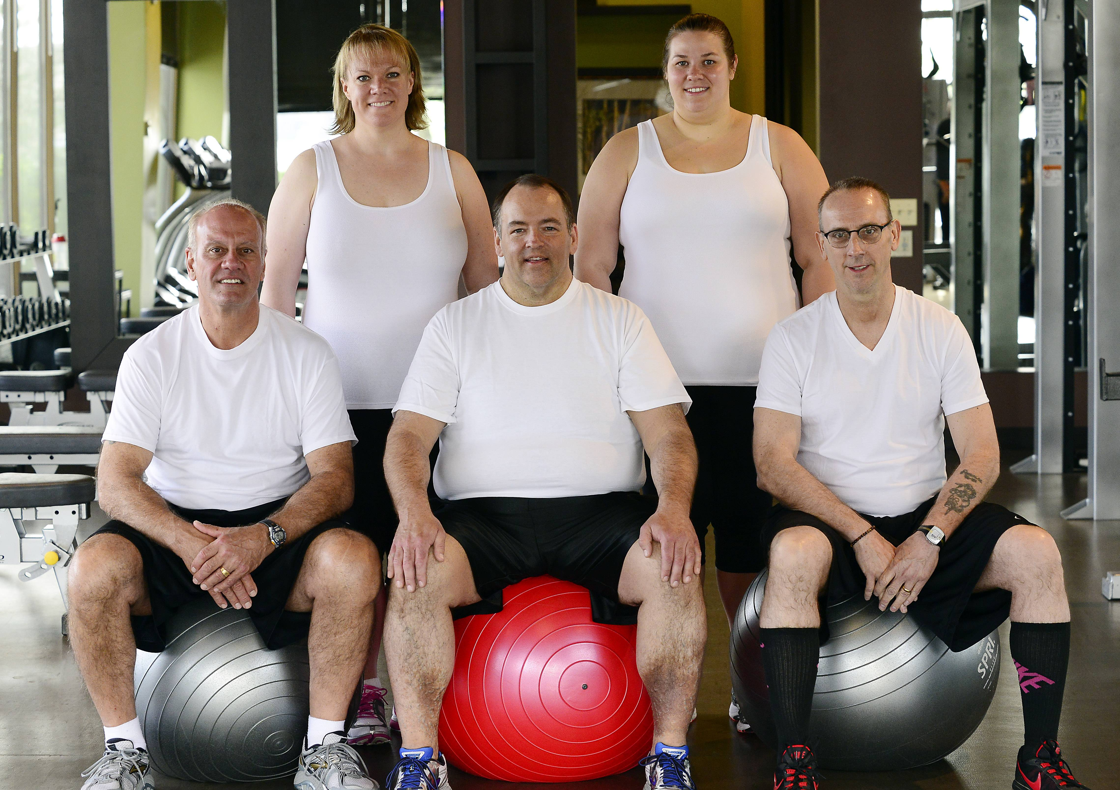 Twelve weeks later and 285 pounds lighter, the 2014 Fittest Losers pose for an updated photo.