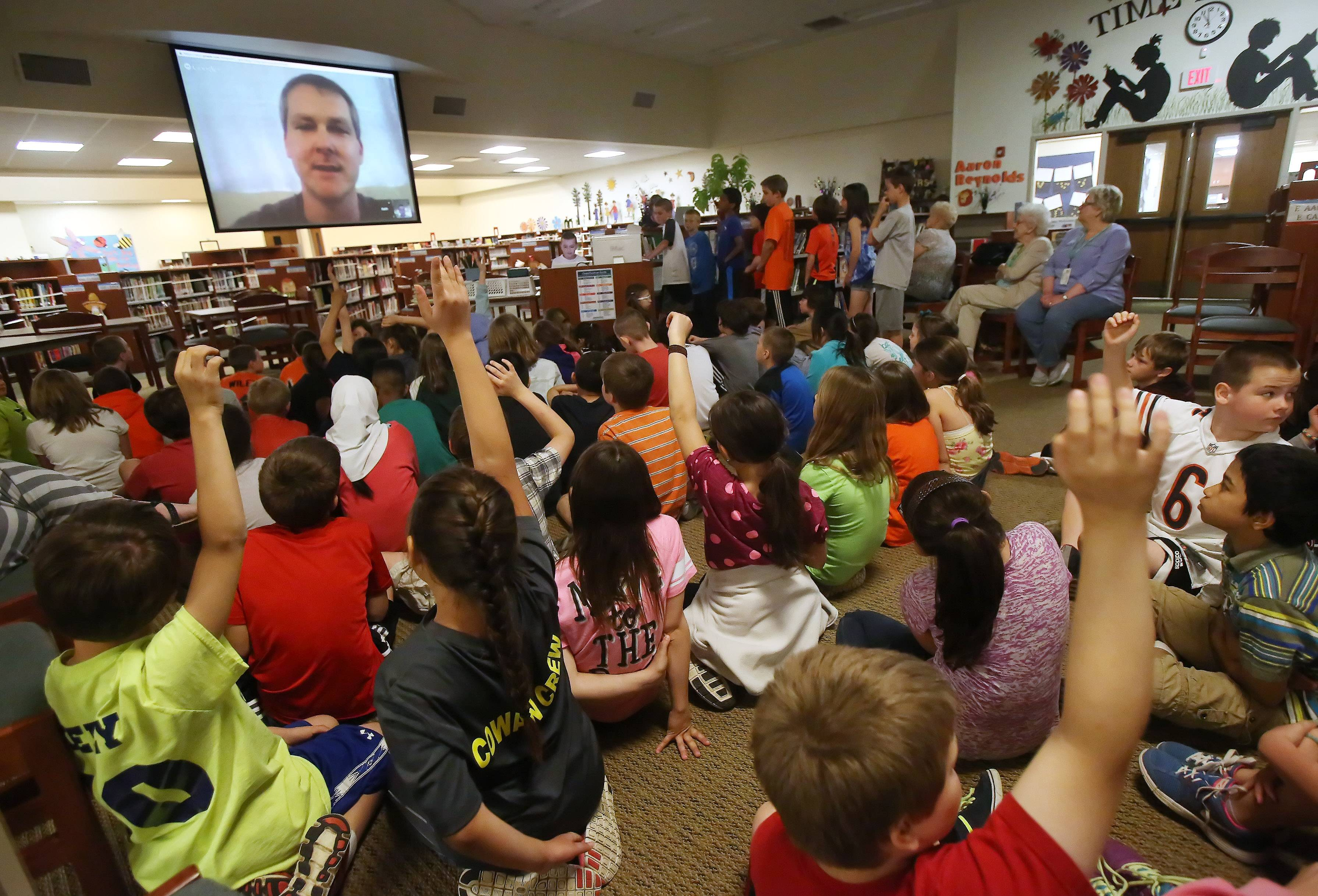 Fourth grade students participate in a video chat with marine biologist Keith Fischer Monday in the learning center at Butterfield School in Libertyville. Fischer, who works with the Fish and Wildlife Institute in St. Petersburg, Fla., discussed ecosystems with the students.
