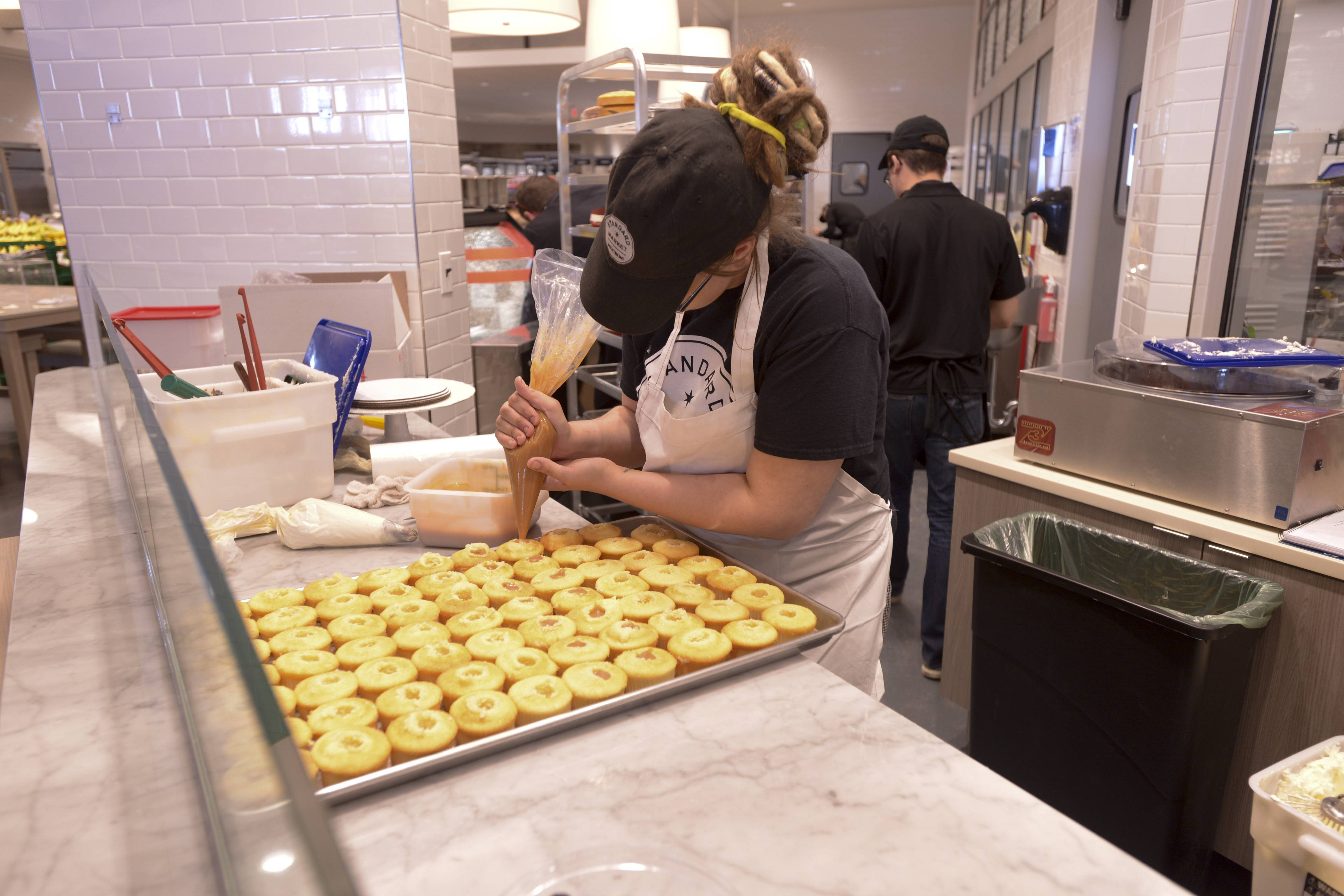 Bakers and pastry chefs at Standard Market's new store in Naperville make most items from scratch in a kitchen behind wide windows so customers can see them at work. Started in Westmont in 2011, Standard Market will open its second location Tuesday at 1508 Aurora Ave. in Naperville.