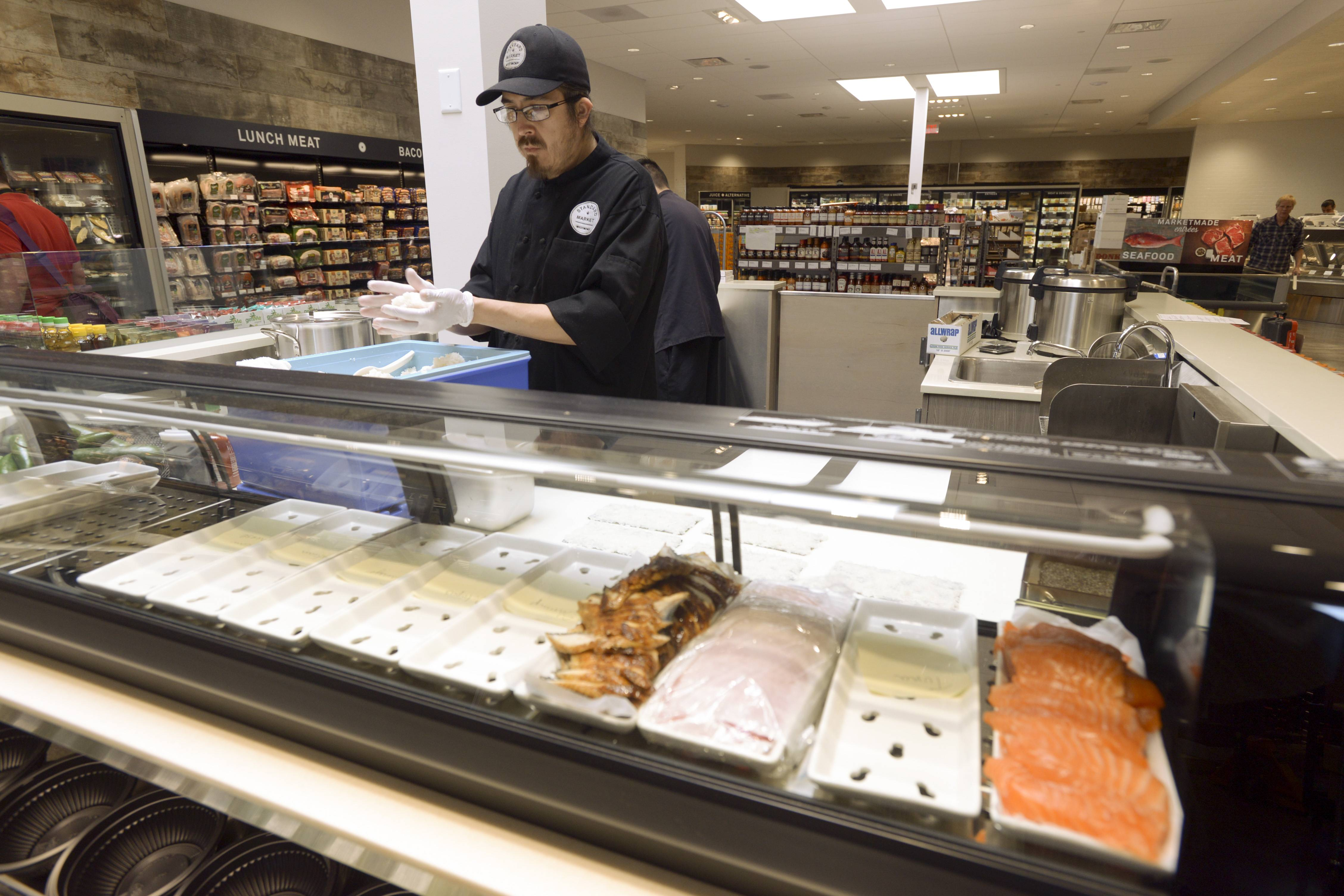 The sushi bar at Standard Market in Naperville will use fresh fish flown in each day.