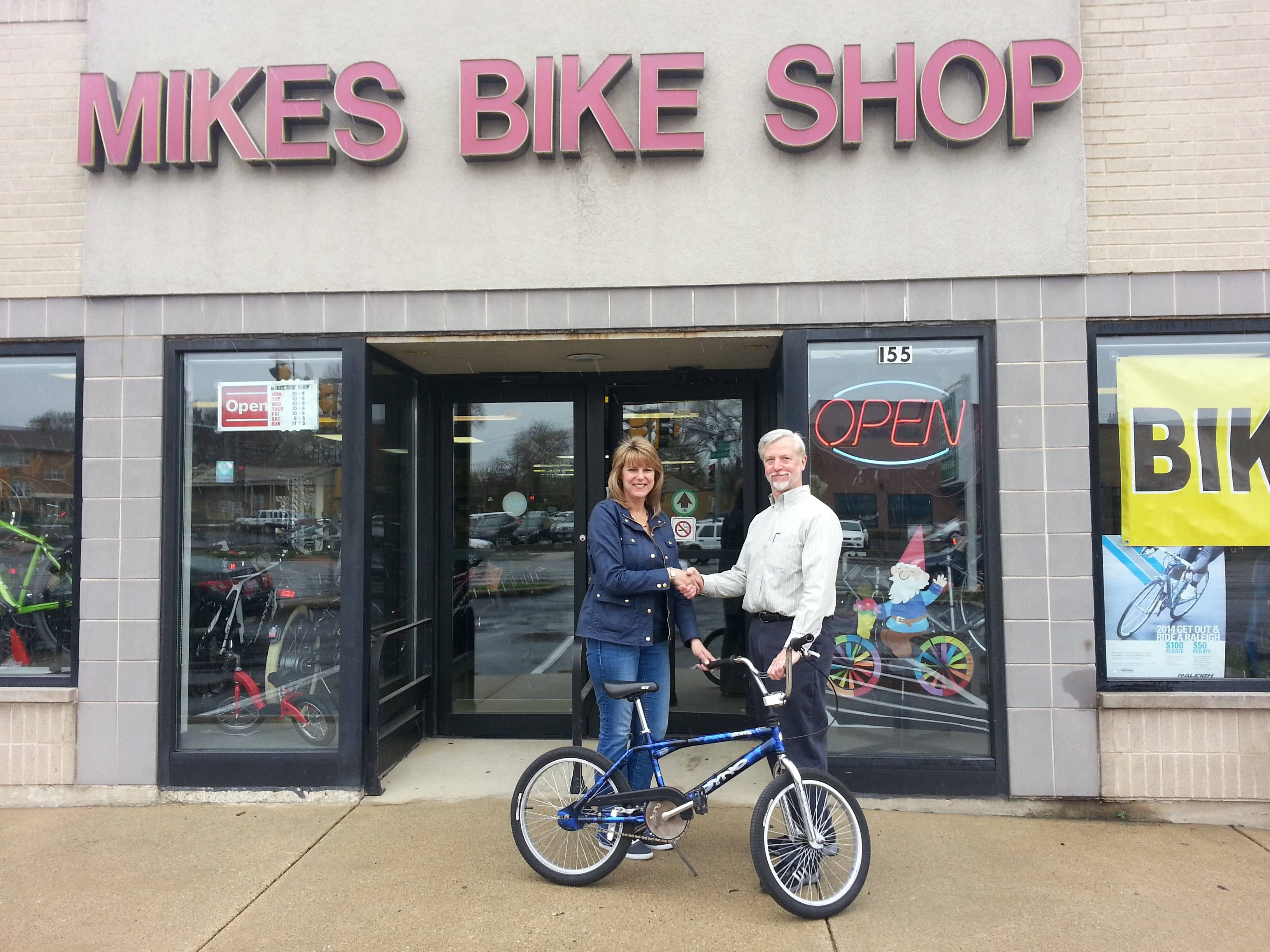 Wayne Mikes donates a bike to the Palatine Opportunity Center, received by Debbie Rohrwasser of Palatine, a volunteer with the Center.