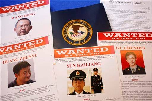 Press materials are seen on a table of the Justice Department in Washington, Monday. Attorney General Eric Holder said Monday a U.S. grand jury has charged five Chinese officials with economic espionage and trade secret theft, the first-of-its-kind criminal charges against Chinese military officials in an international cyber-espionage case.