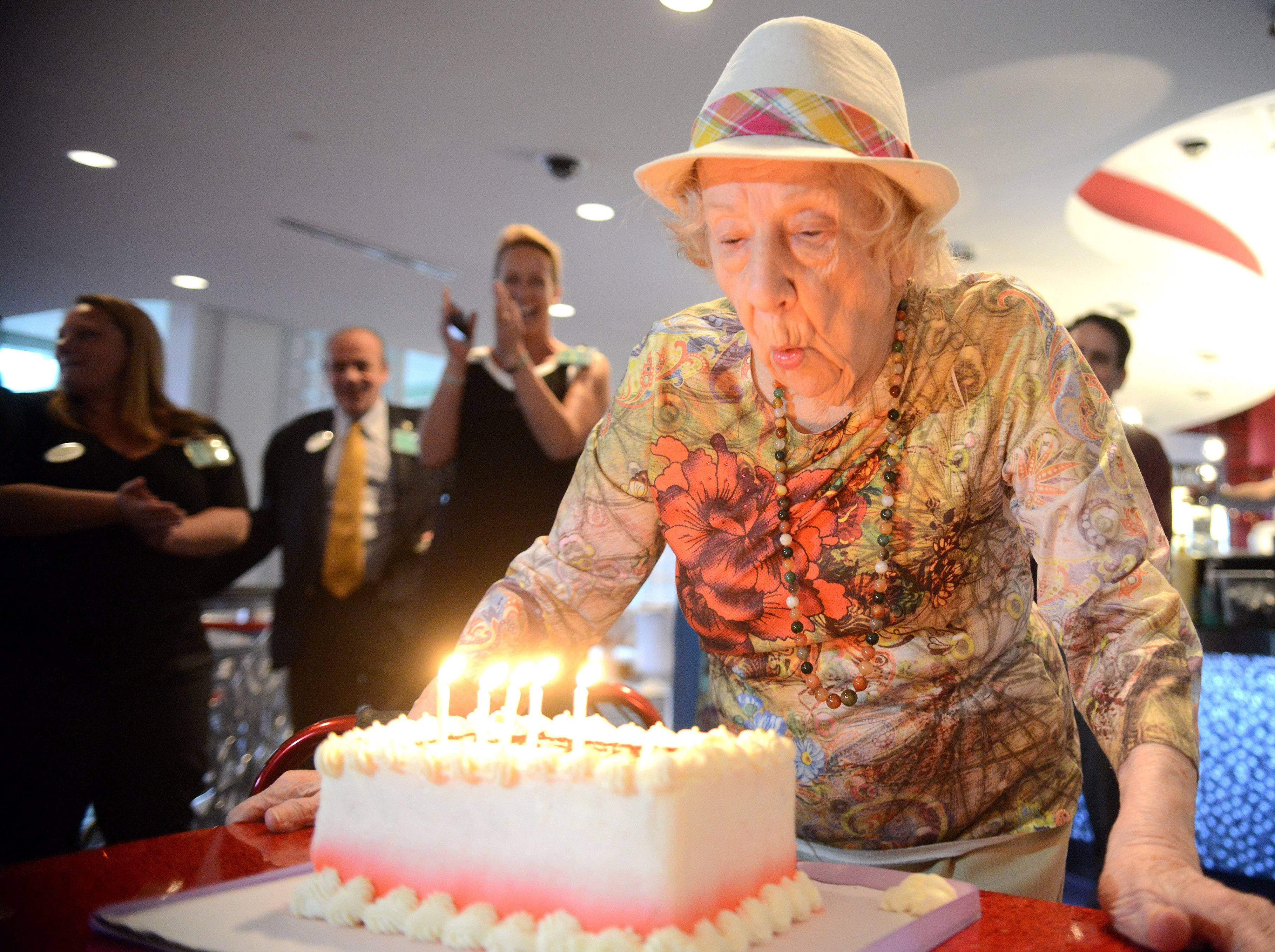 "Clarice Colangelo, of Elmhurst, blows out the candles while celebrating her 101st birthday at Prime BurgerHouse at the Grand Victoria Casino in Elgin Monday. She been coming to gamble at the casino every Monday and Thursday for about 8 years. She used to come with her sister before her passing, but now comes with either her son Larry or daughter Lenice. Her family and many staff members gathered to help her celebrate and sing. She said she usually plays video poker or slots and the most she's won in one day was about $600. ""Where else can you get this kind of excitement, the grocery store?,"" she asked."