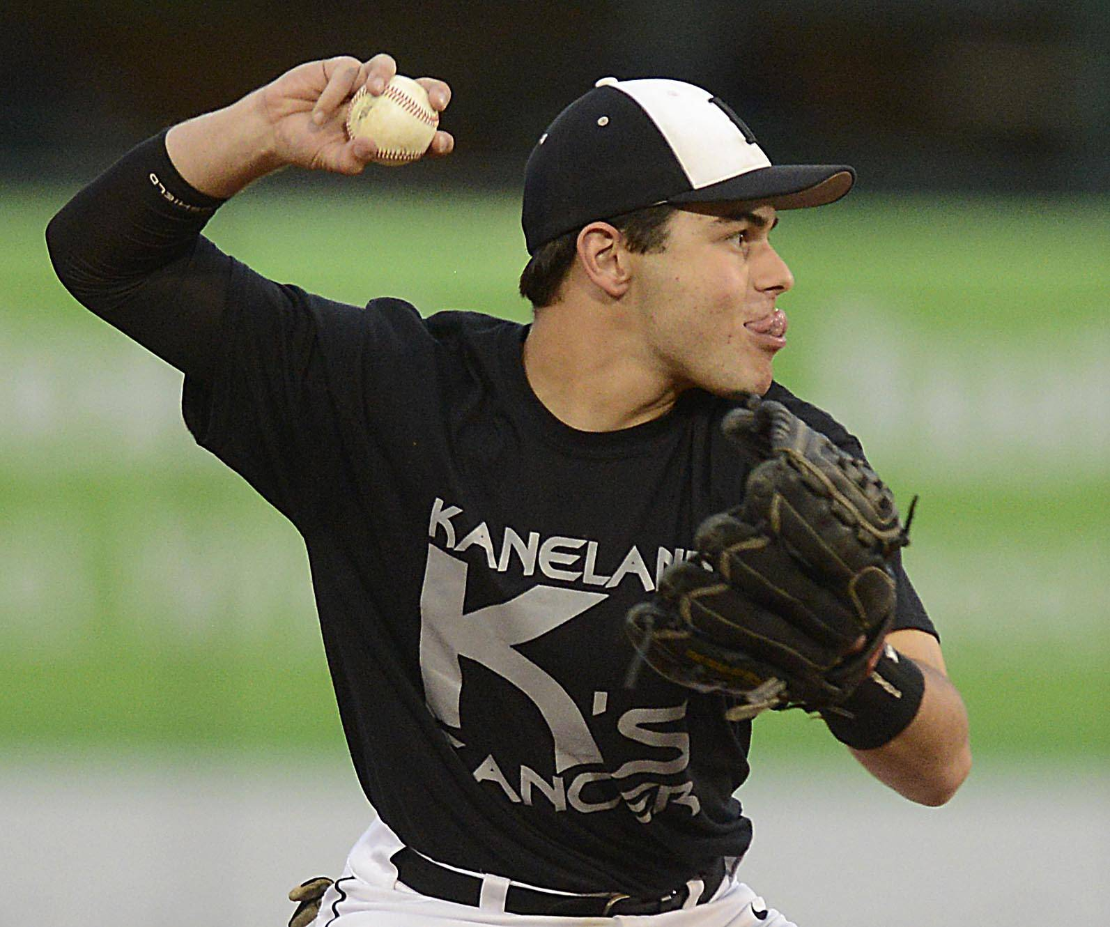 Kaneland's Joe Panico sticks out his tongue as he throws out Batavia's Kyle Niemiec Monday at Fifth Third Ballpark in Geneva.