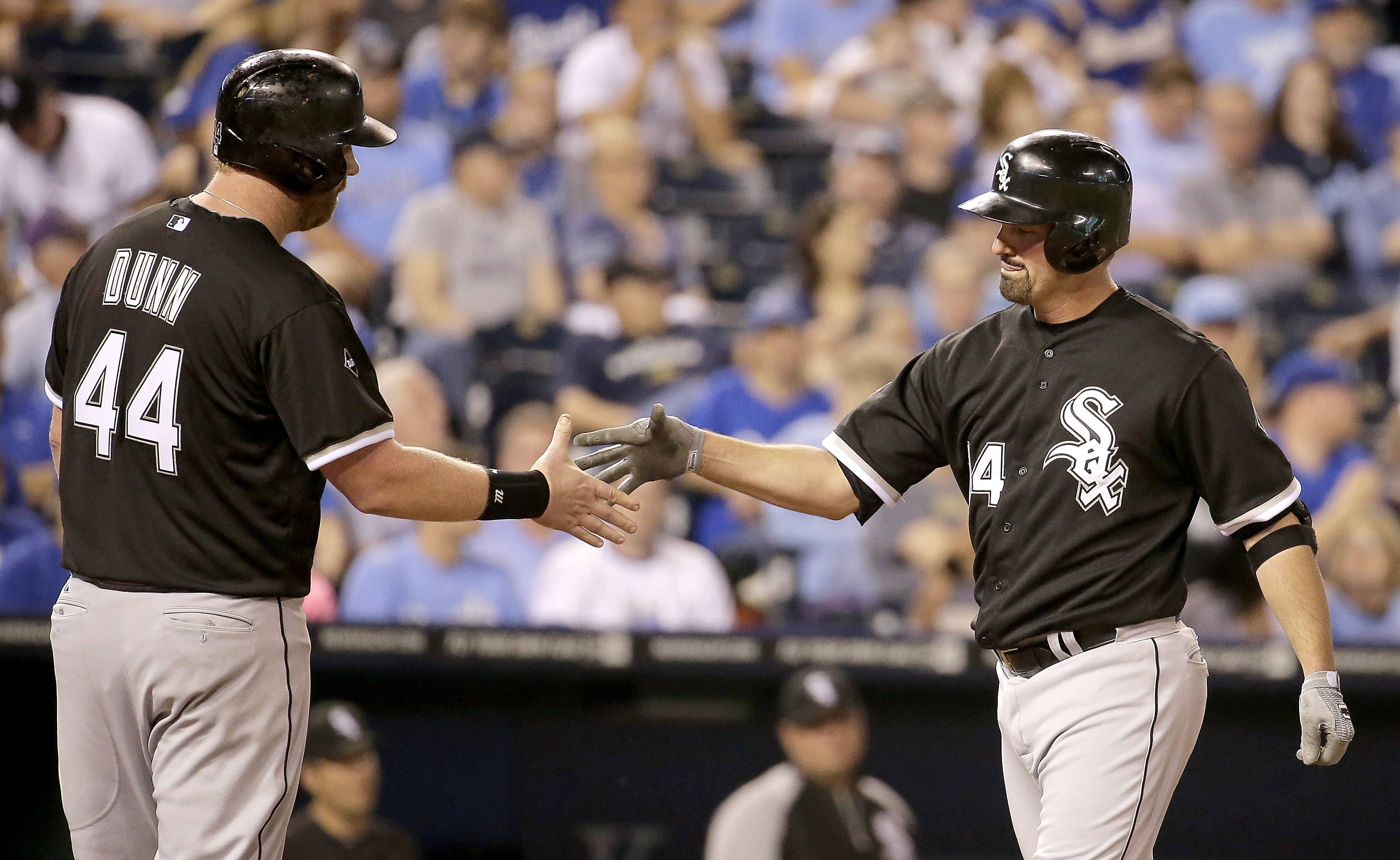 Chicago White Sox's Paul Konerko, right, celebrates with Adam Dunn (44) after hitting a two-run home run Monday night during the fifth inning of a baseball game against the Kansas City Royals in Kansas City, Mo.