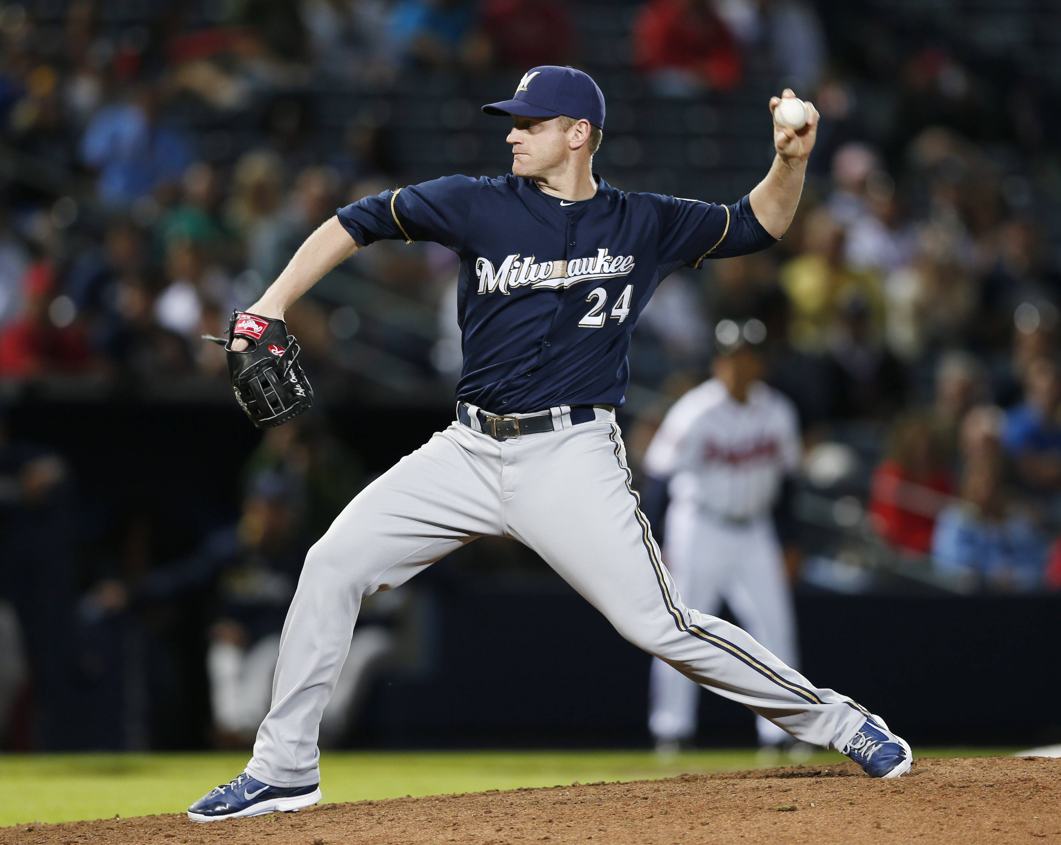 Milwaukee Brewers' Lyle Overbay pitches in the eighth inning of a baseball game Monday against Atlanta Braves in Atlanta. Atlanta won 9-3.