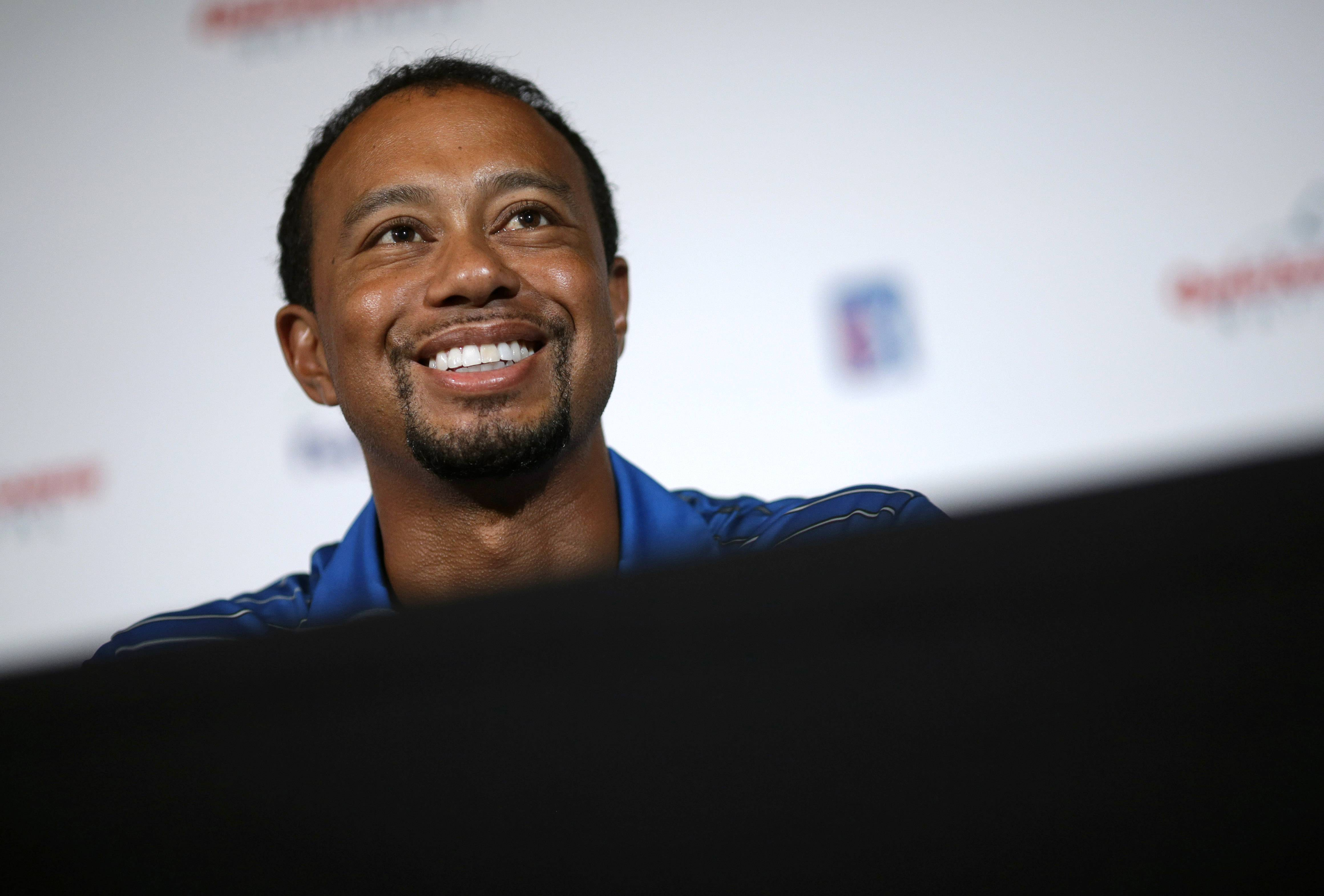 Golfer Tiger Woods speaks at a Quicken Loans National PGA tournament media day news conference Monday at Congressional Country Club in Bethesda, Md. Woods said his back injury was so debilitating that it caused him to doubt whether he would play golf again. While the surgery he had March 31 erased those doubts, he still has no timetable for his return.