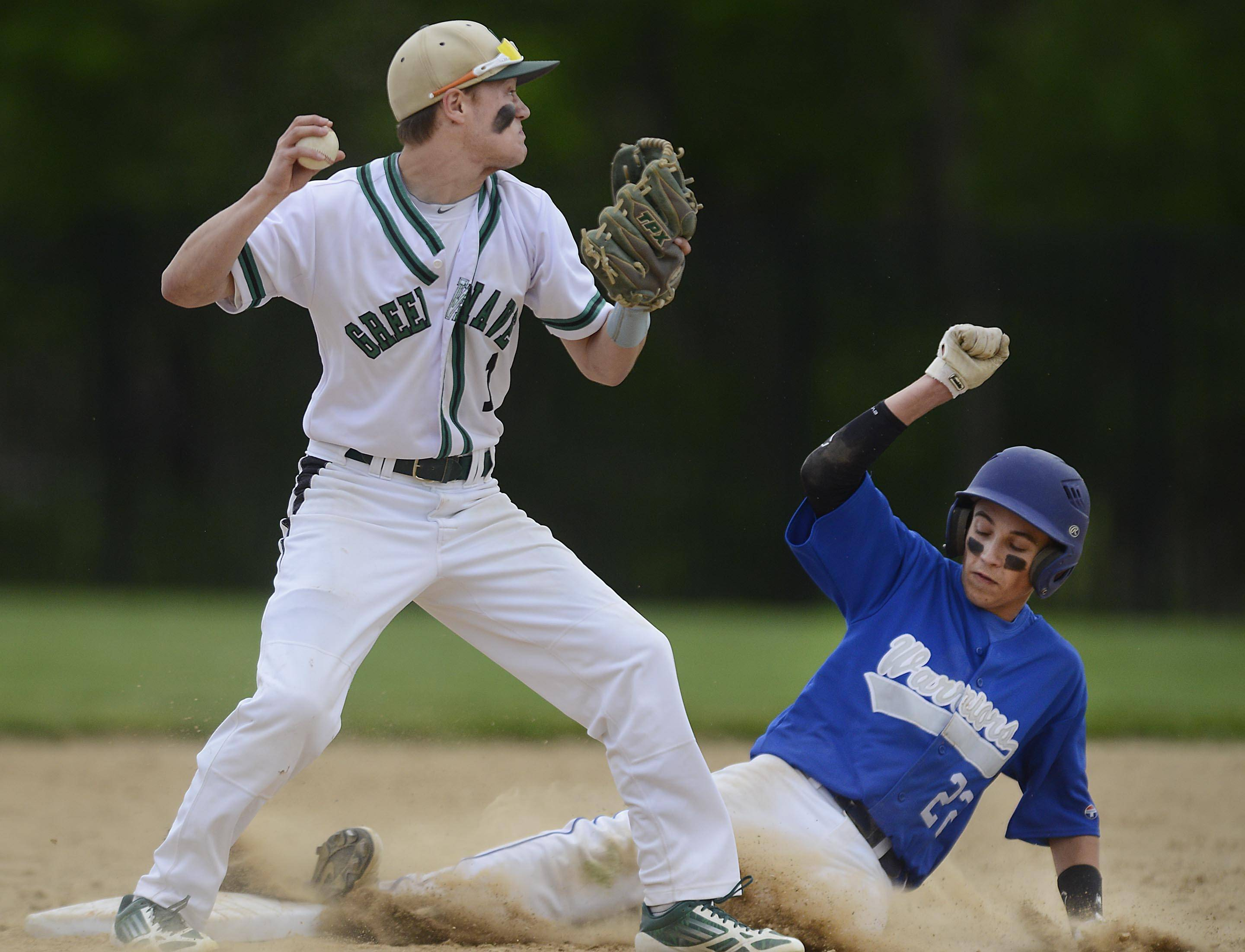 St. Edward's Michael Castoro forces out Westminster Christian's Ian Merlak as second base Monday in the Class 2A regional game at Wing Park in Elgin.