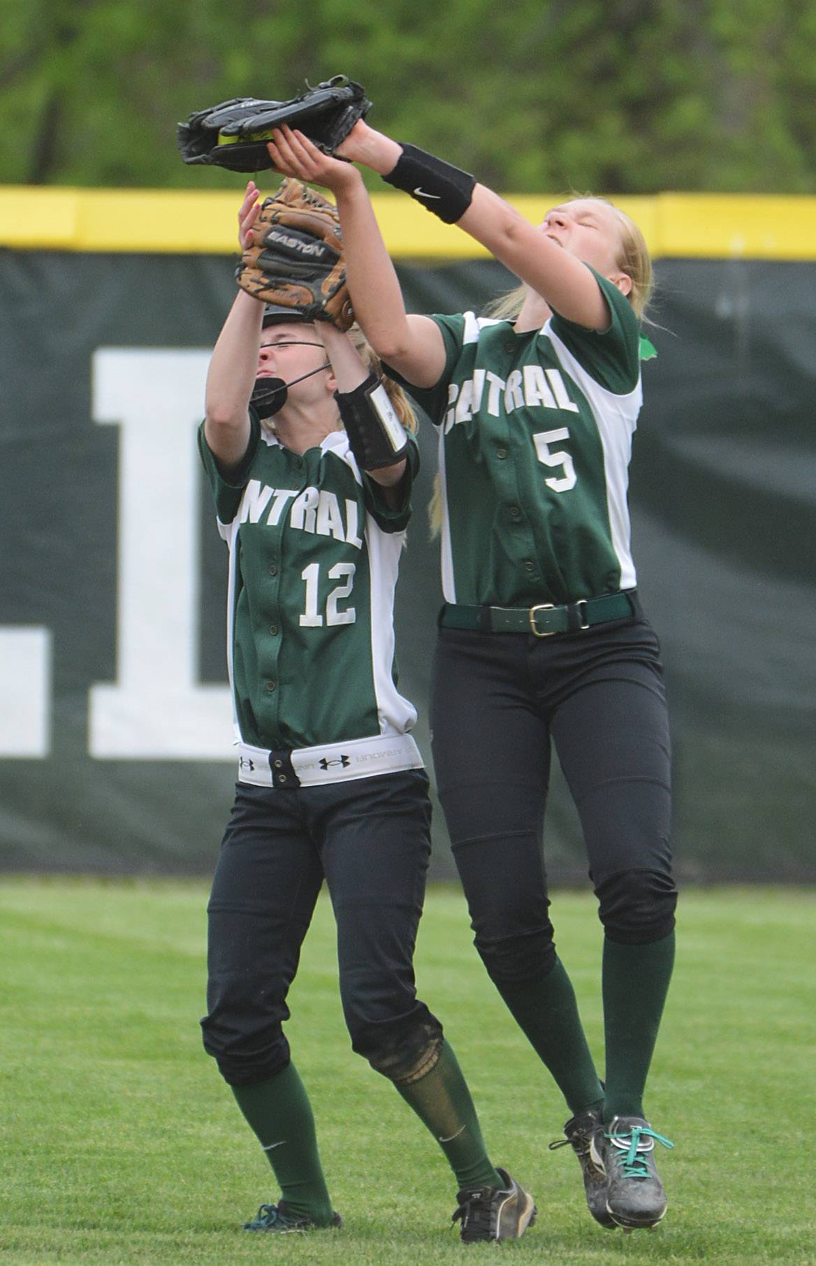 Grayslake Central's Reagen Radke (5) catches a popup next to teammate Shelby White (12) during Monday's game against Grayslake North.