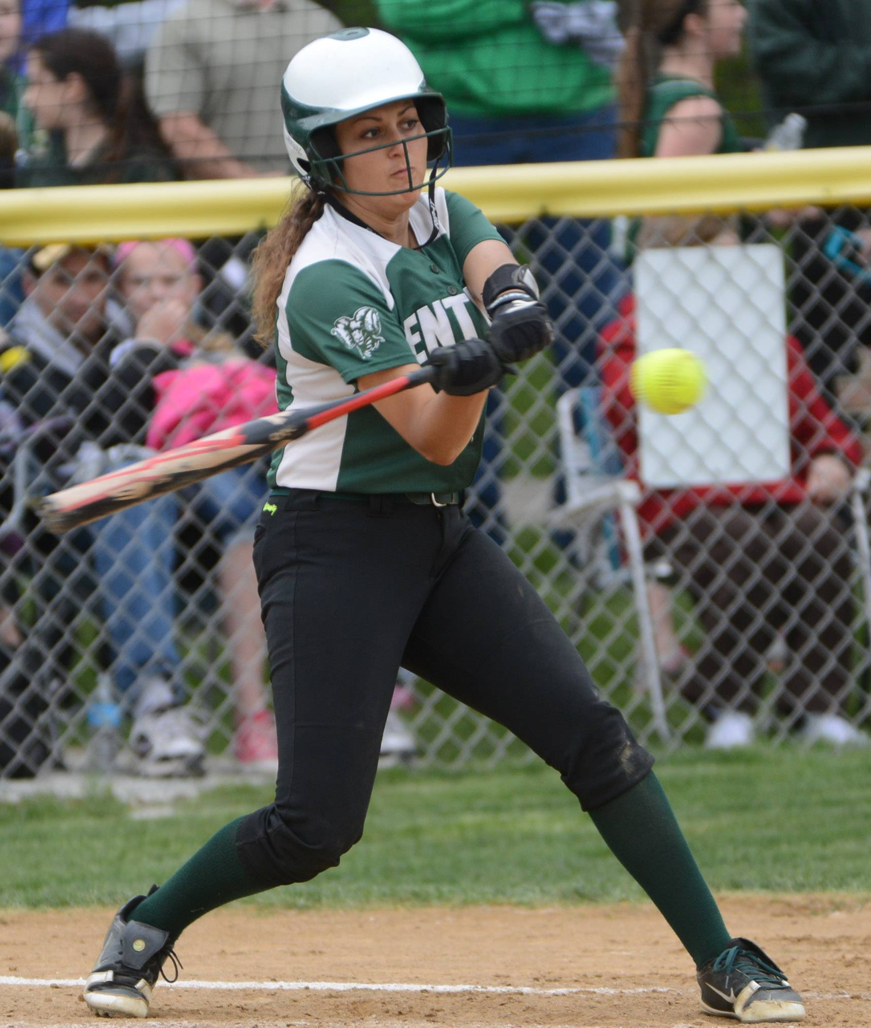 Grayslake Central's Juliana Frusolone gets a hit against Grayslake North on Monday.