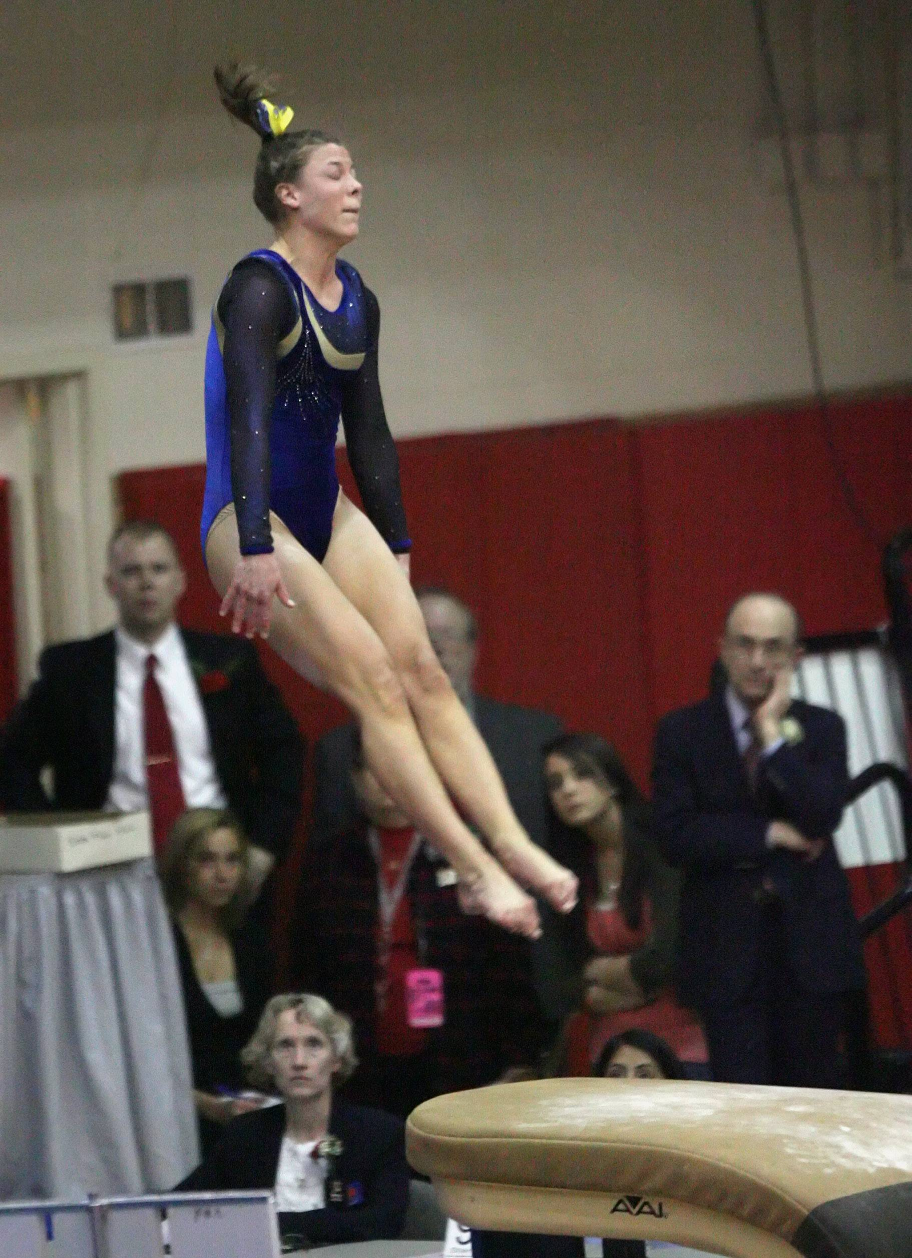 Warren's Kim Gotlund, here competing with Warren in the vault finals in the girls gymnastics state meet, has been selected for a Mid-American Conference Medal of Excellence for her efforts at Northern Illinois.