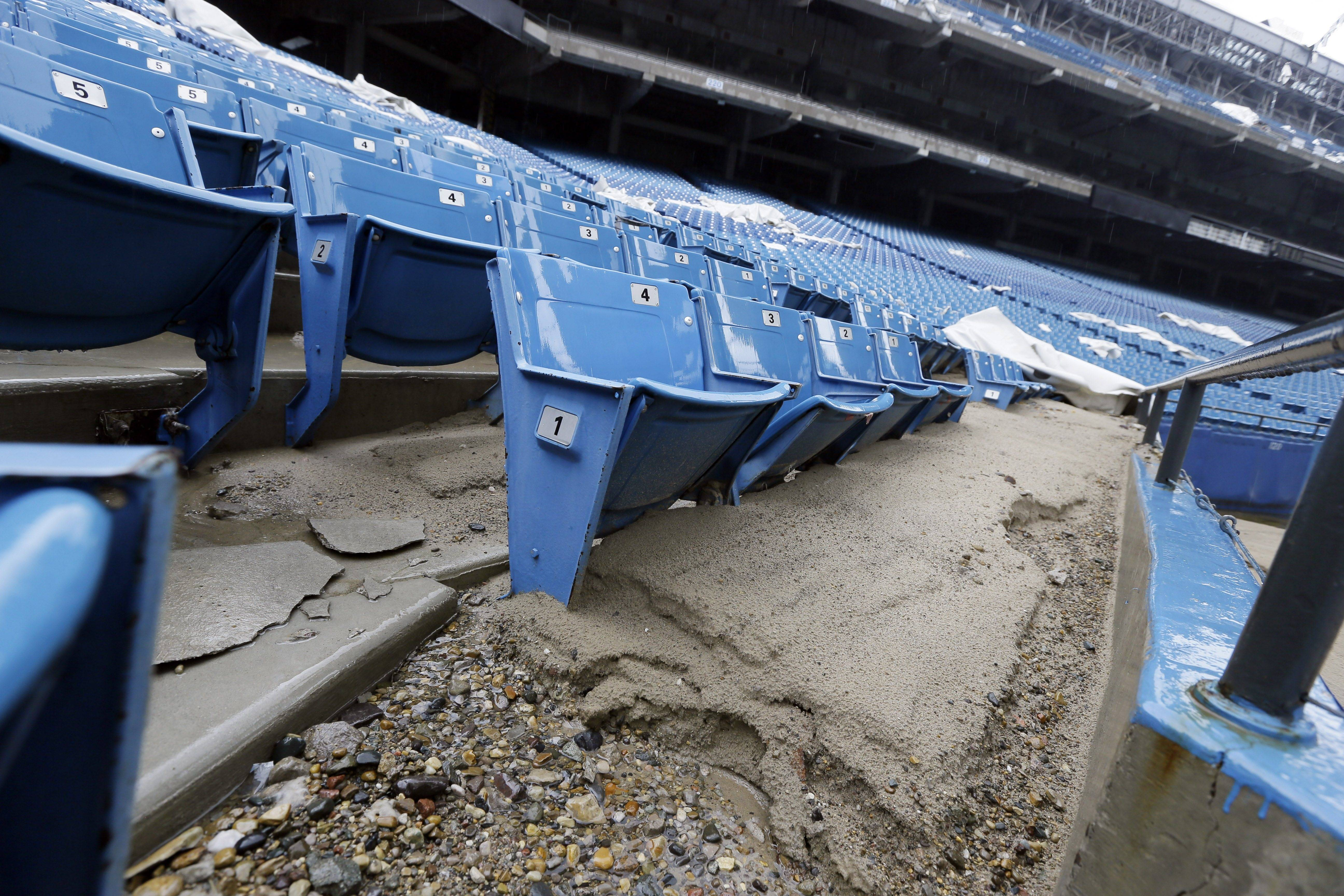 Foundation sand from cracked cement covers seats inside the Pontiac Silverdome in Pontiac, Mich. The 80,000-seat indoor stadium hosted the Super Bowl, the NBA finals, the World Cup, Wrestlemania and concerts by Elvis Presley, Led Zeppelin and the Rolling Stones.