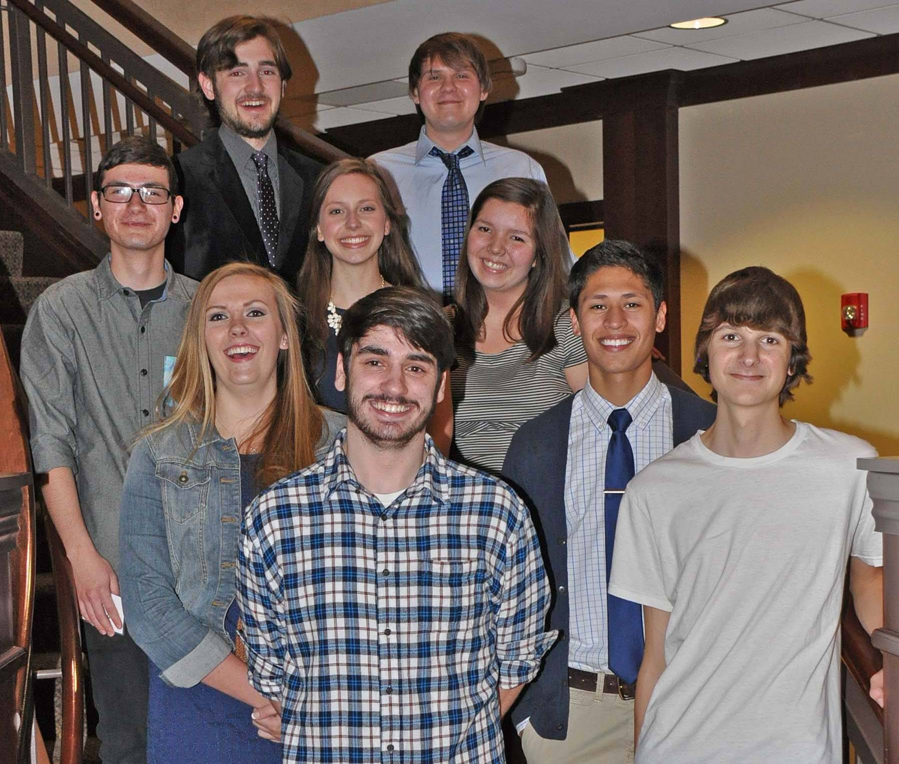 Holmstad residents awarded $9,000 in college scholarships to dining services employees: first row, from left, Joseph Doyle and Mitchell Kavalec; 2nd row, Francisco Gama, Delaney Corbitt, Stephanie Condon; 3rd row, Alice Paul, Gabriel Monarrez; and back row, Jeffrey Heise and Benjamin Borowiak.