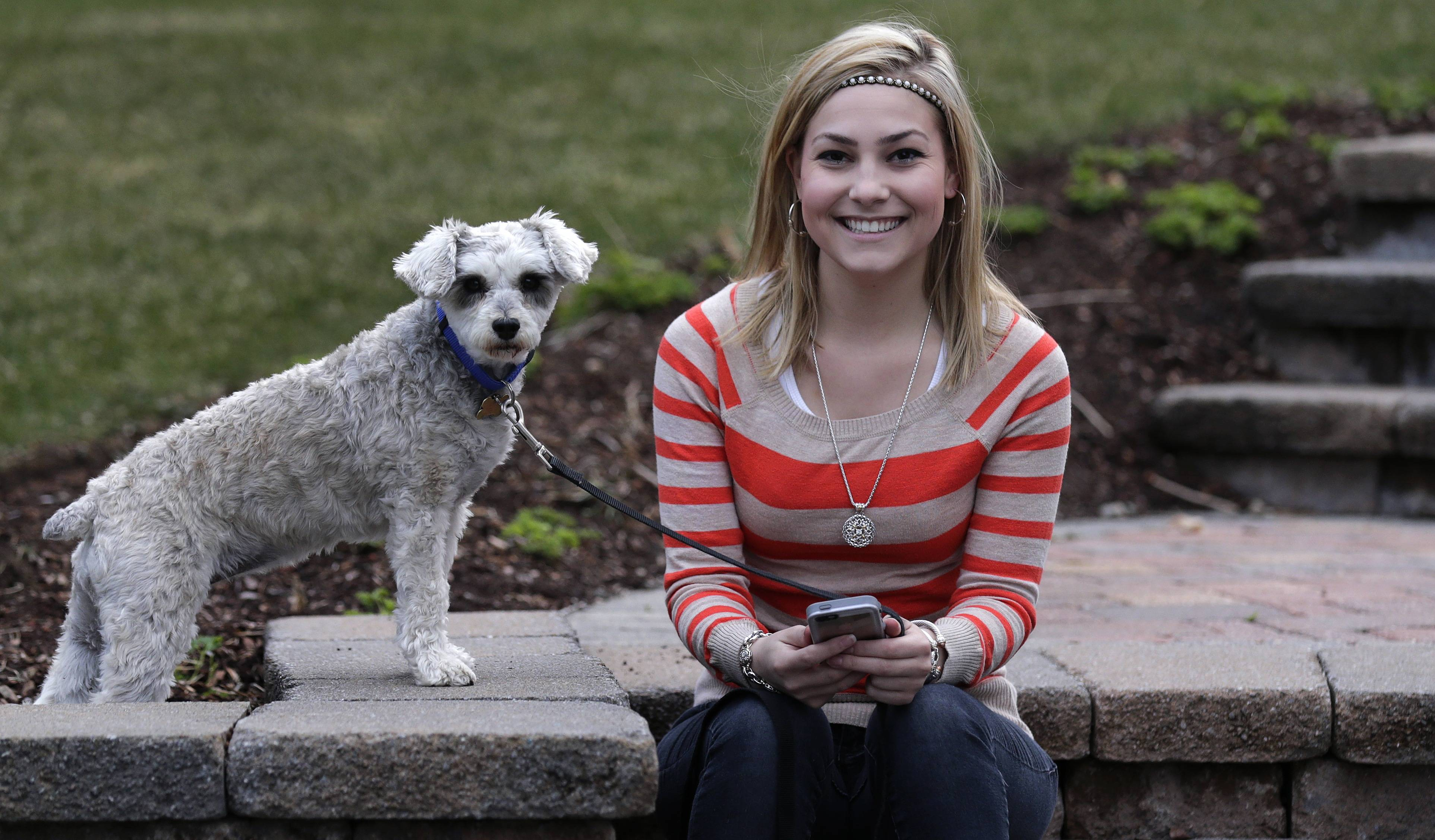 Associated Press In this April 23, 2014 photo, Melissa Ellard with her dog, Nike, in Foxborough, Mass. Ellard says she wouldn't have gone on a date in the past six months were it not for Hinge, a dating app whose promise hinges on its ability to hook you up with friends of friends.