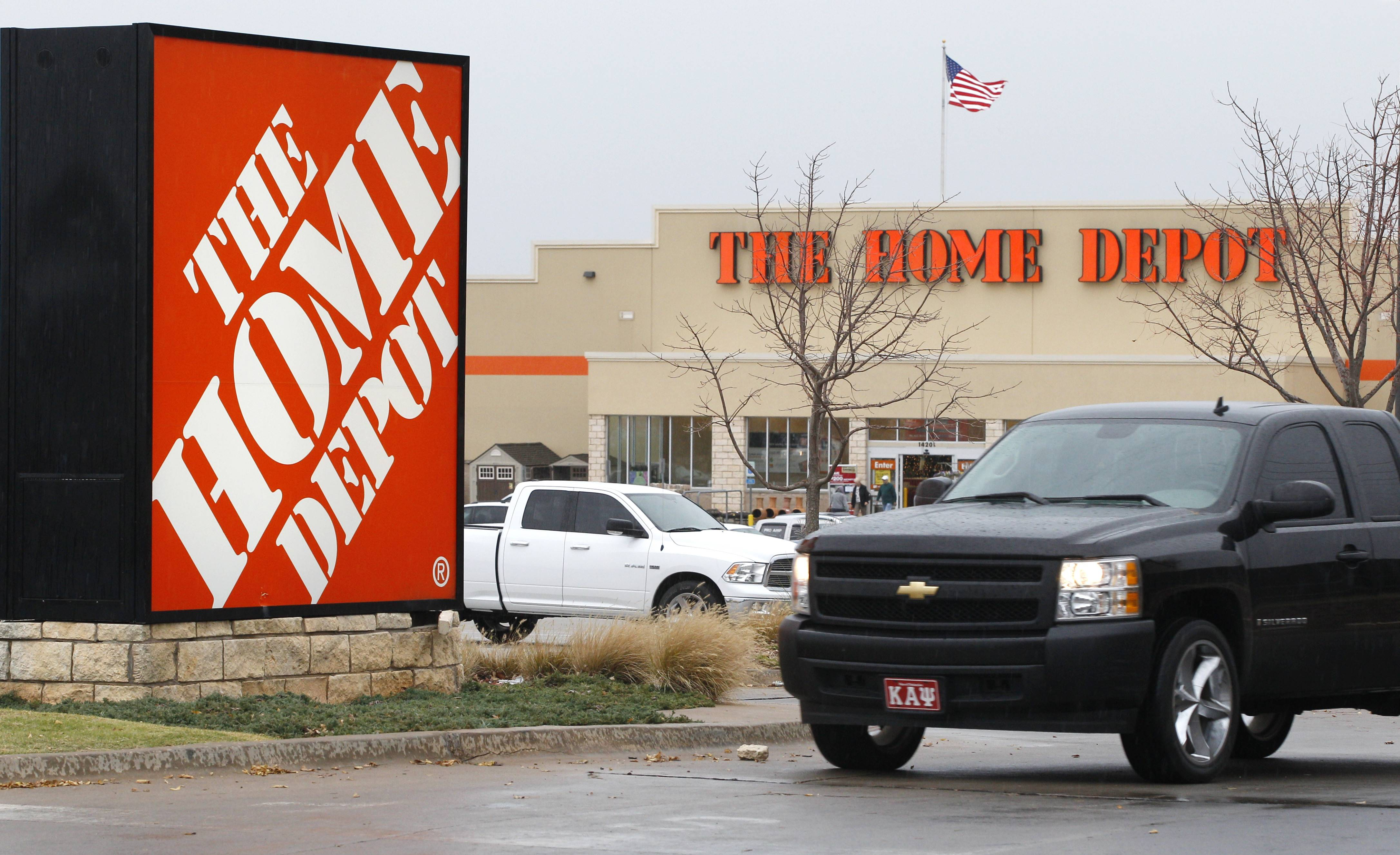 Home Depot's fiscal first-quarter net income climbed 12 percent as a key sales metric improved despite a slow start to the spring selling season due to bad weather.