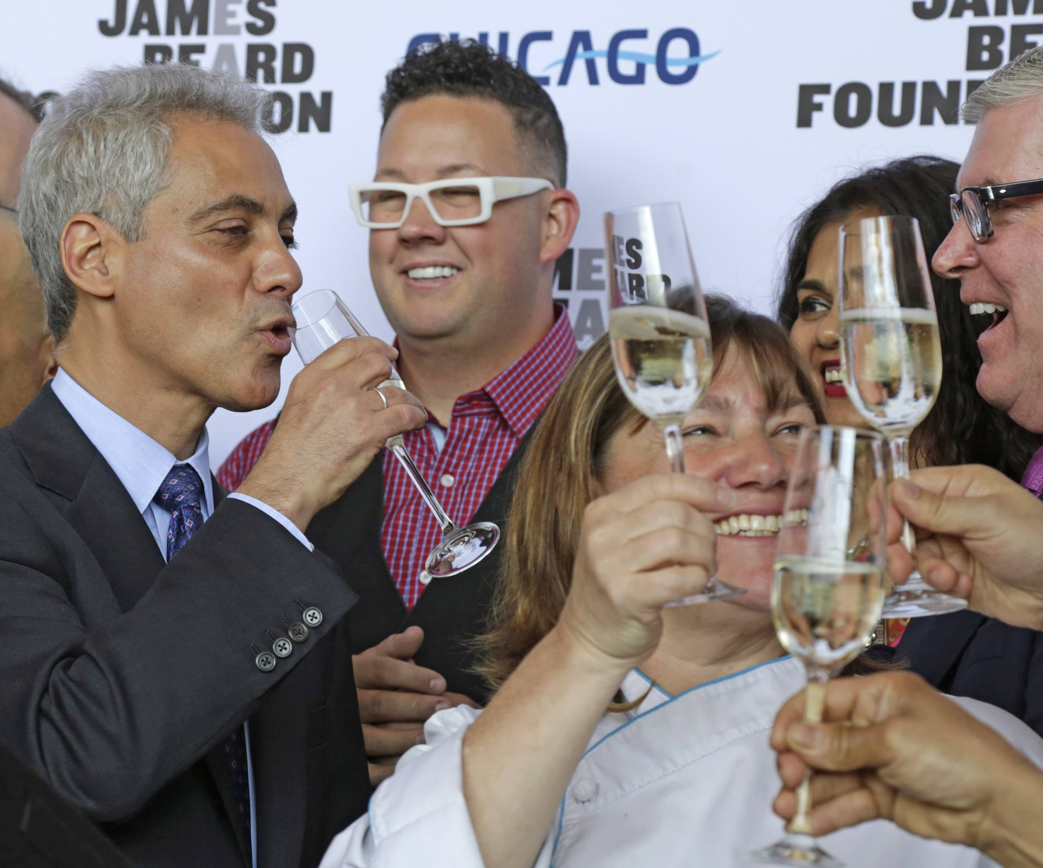 Chicago Mayor Rahm Emanuel, left, toasts with some of the cities top chefs including Grahm Elliott, center, and Gale Gand, lower right, at a news conference Tuesday in Chicago. The James Beard Foundation said Tuesday that after 24 years in the New York, the foundation's awards ceremony is moving to the Windy City next year. The foundation — which is based in New York and honors the nation's best chefs, restaurants and food media — says several cities had asked to host the annual awards ceremony, but Chicago's offer of marketing and sponsorship support was too good to turn down.
