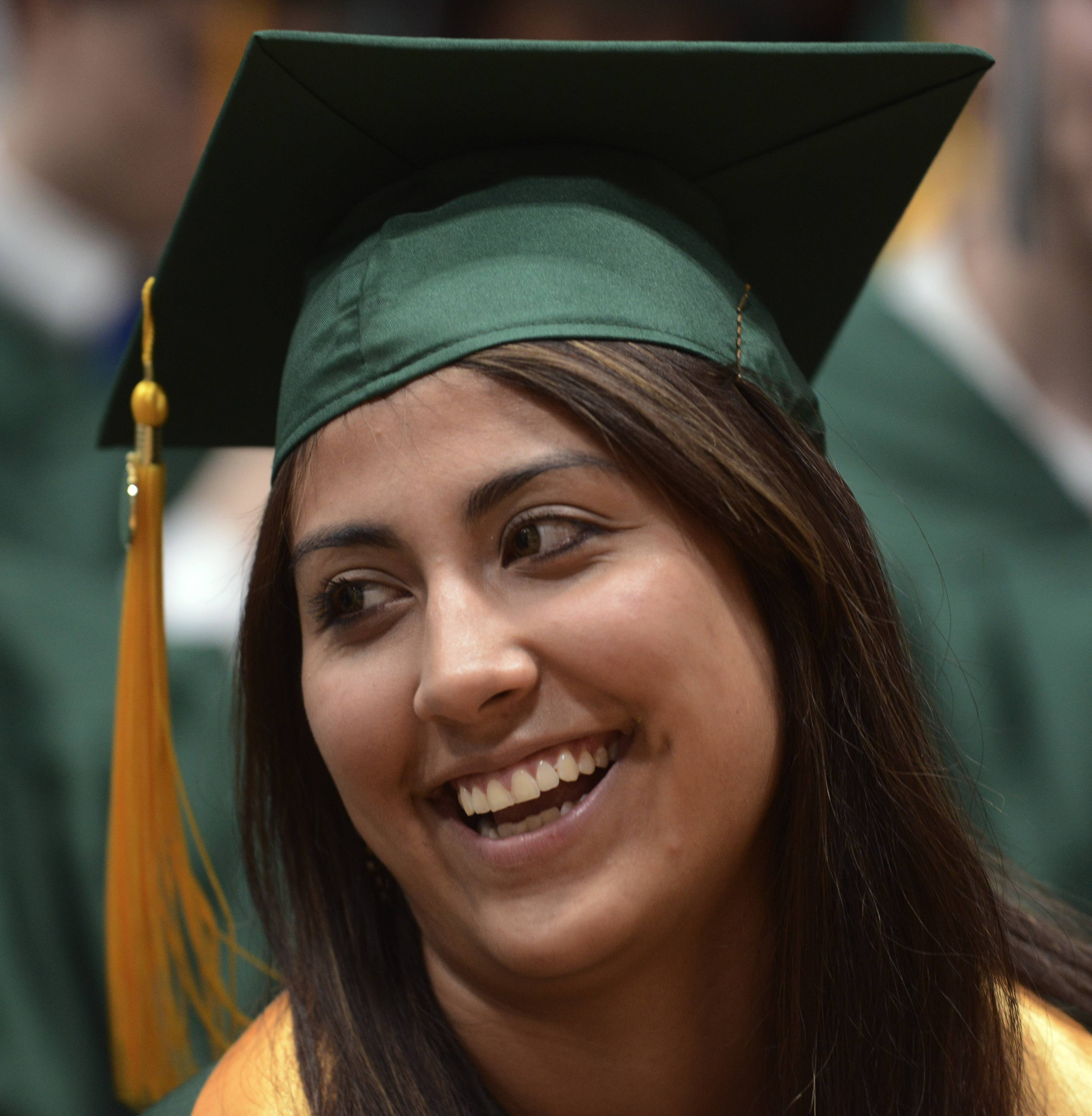 Maria Rice of Des Plaines chats with classmates before the Oakton Community College graduation ceremony Tuesday in Des Plaines